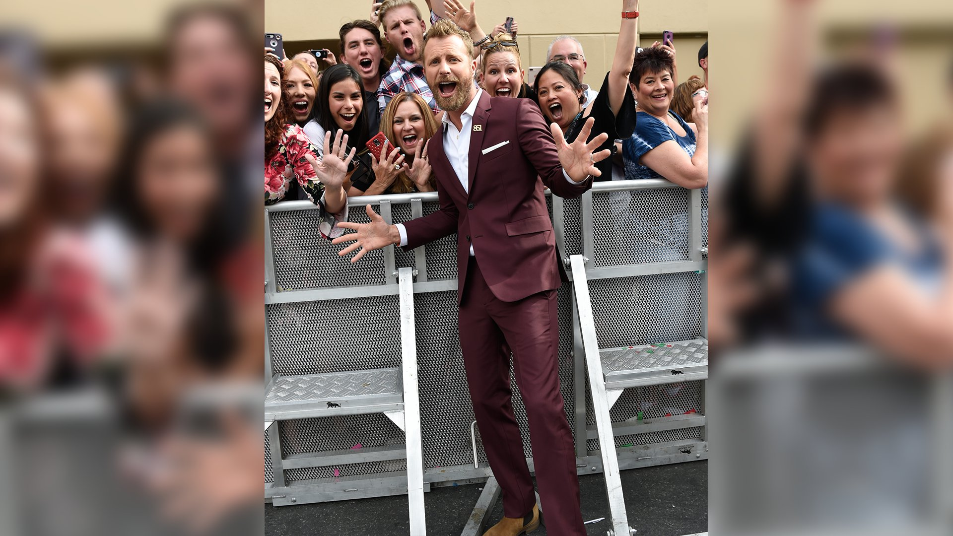 Dierks Bentley can't help but bust out a couple jazz hands while posing with eager fans.