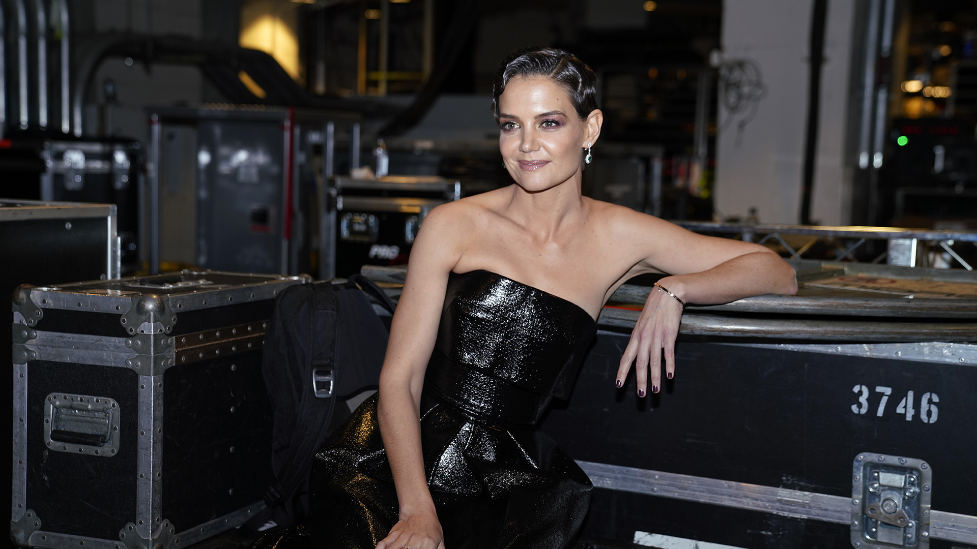 Actress and GRAMMY presenter Katie Holmes takes a minute to relax backstage.