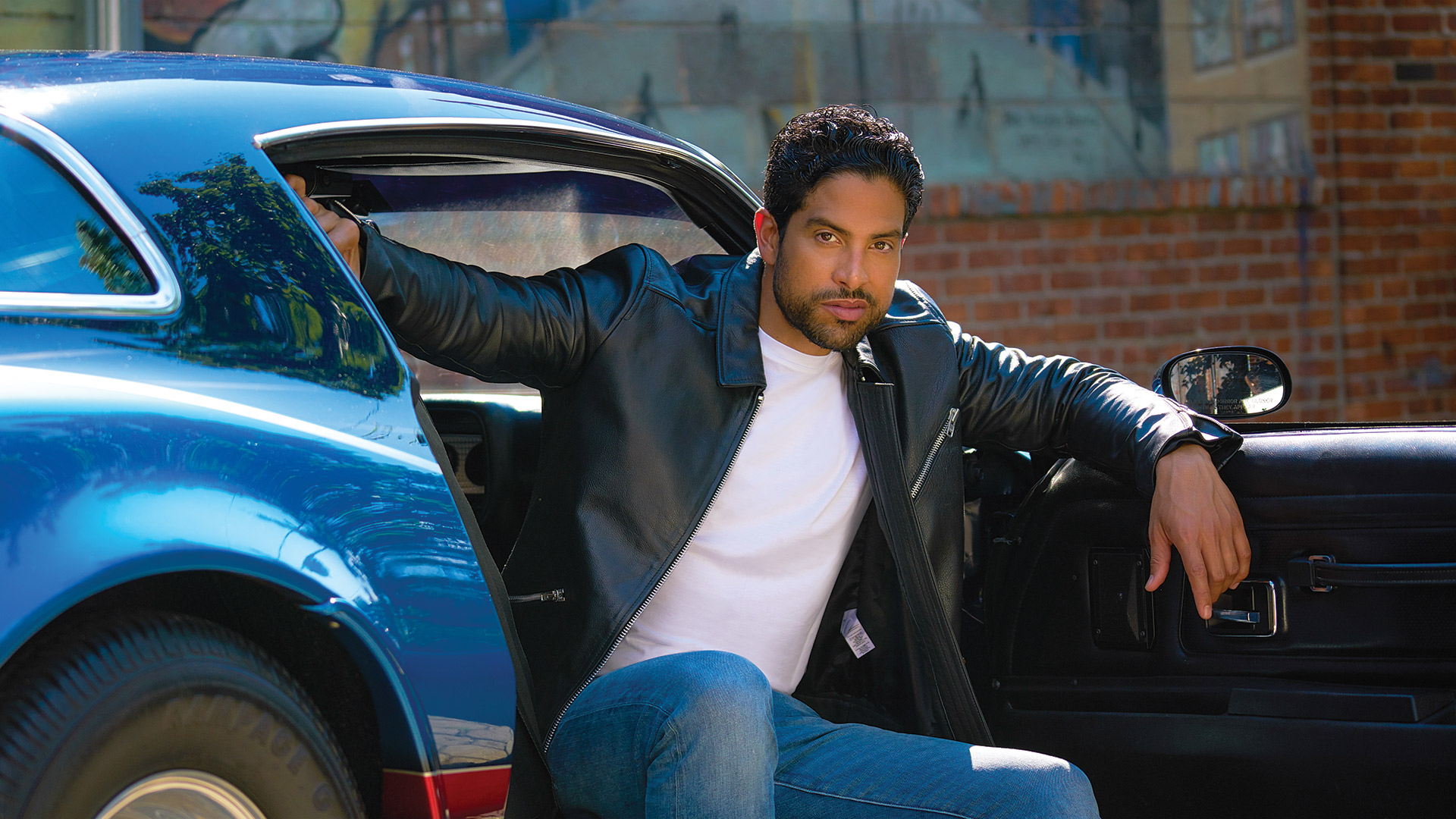 Adam Rodriguez is a hottie in a hot rod