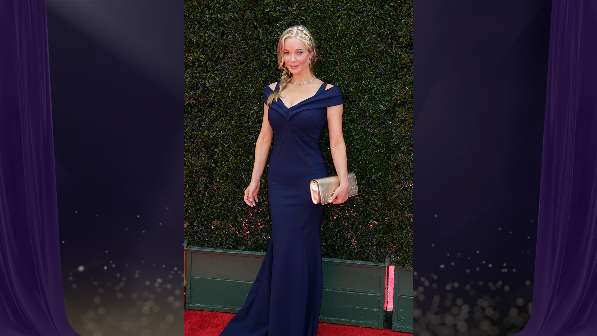 Jennifer Gareis from The Bold and the Beautiful stuns in a navy blue off-the-shoulder dress and gold clutch.