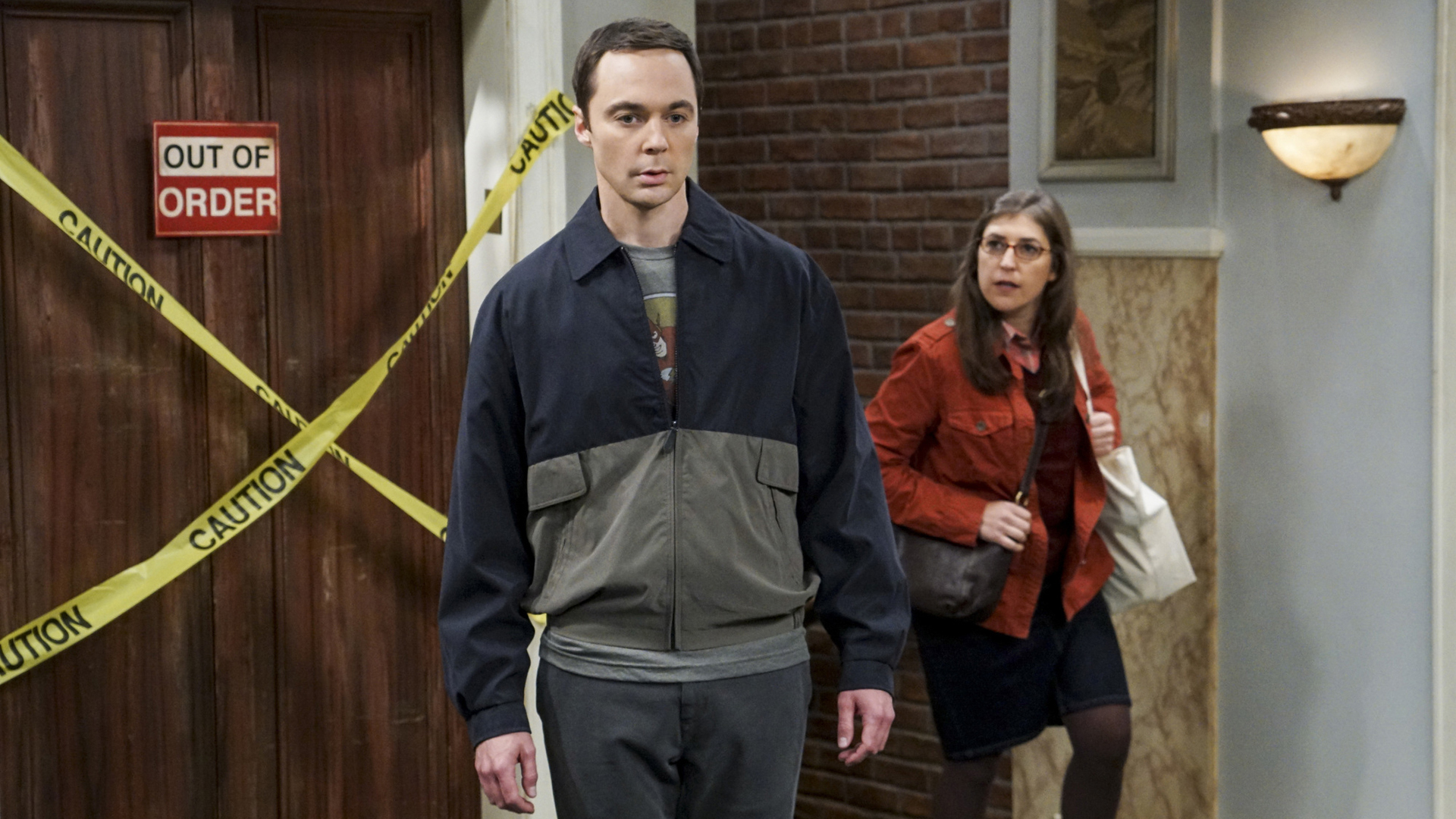 Amy finds Sheldon standing in the middle of the hall.