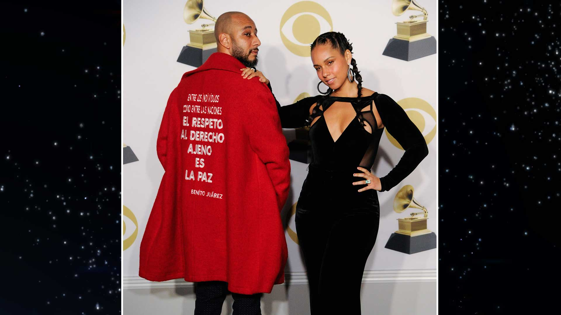 Alicia Keys puts her hand on her husband Swizz Beatz's shoulder as they pose in the GRAMMY press room.