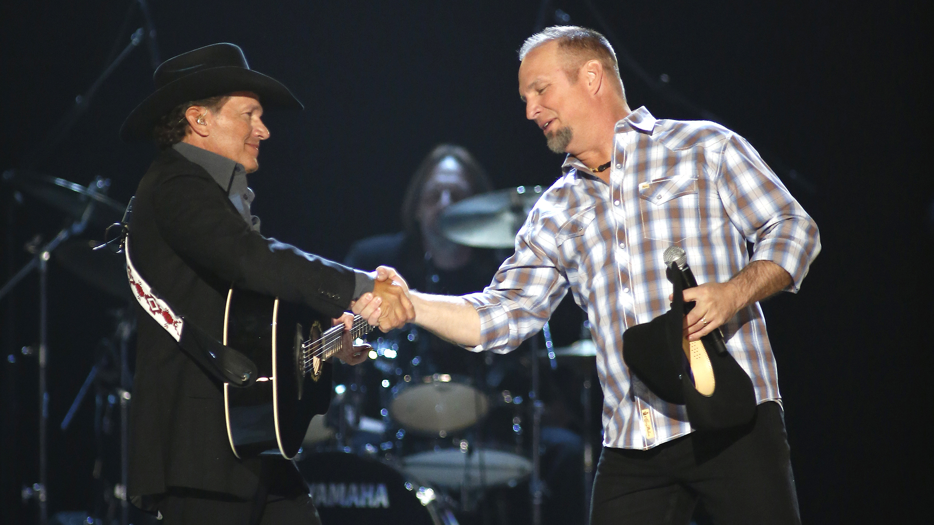 31. Garth Brooks and George Strait perform