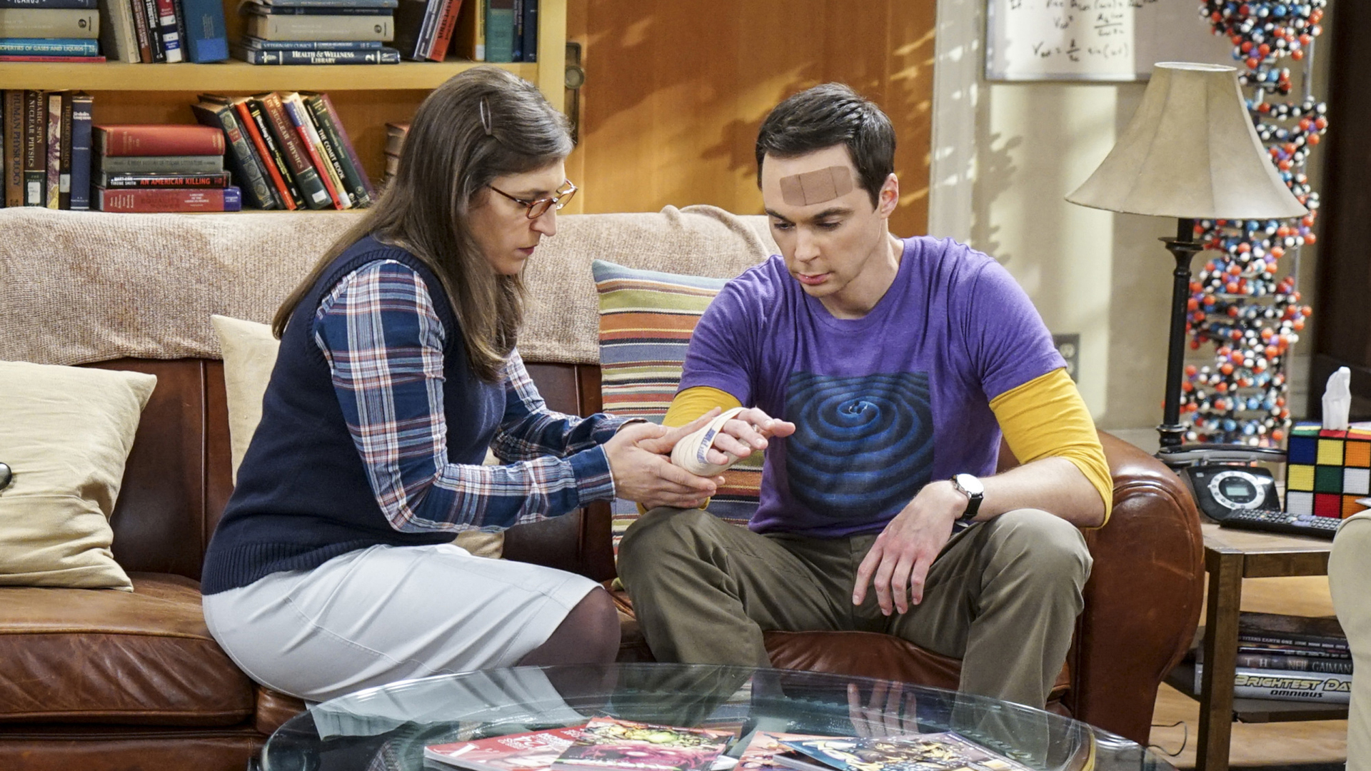 Amy tends to Sheldon's various wounds.