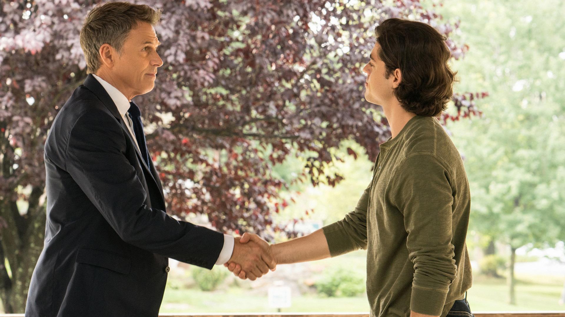 Tim Daly (Henry McCord) shakes Chris Petrovski's (Dmitri Petrov) hand.