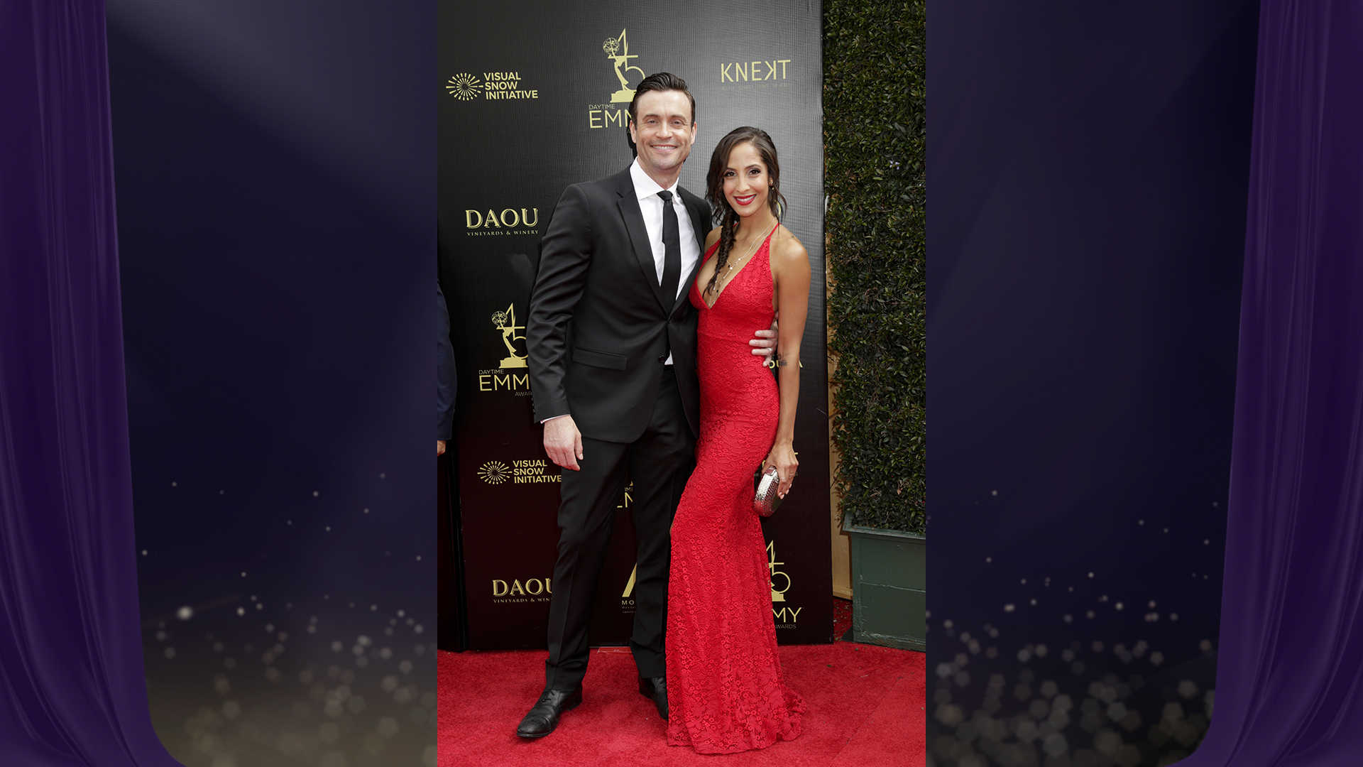 Daniel Goddard from The Young and the Restless stops to pose with costar Christel Khalil before taking their seats for the main event.