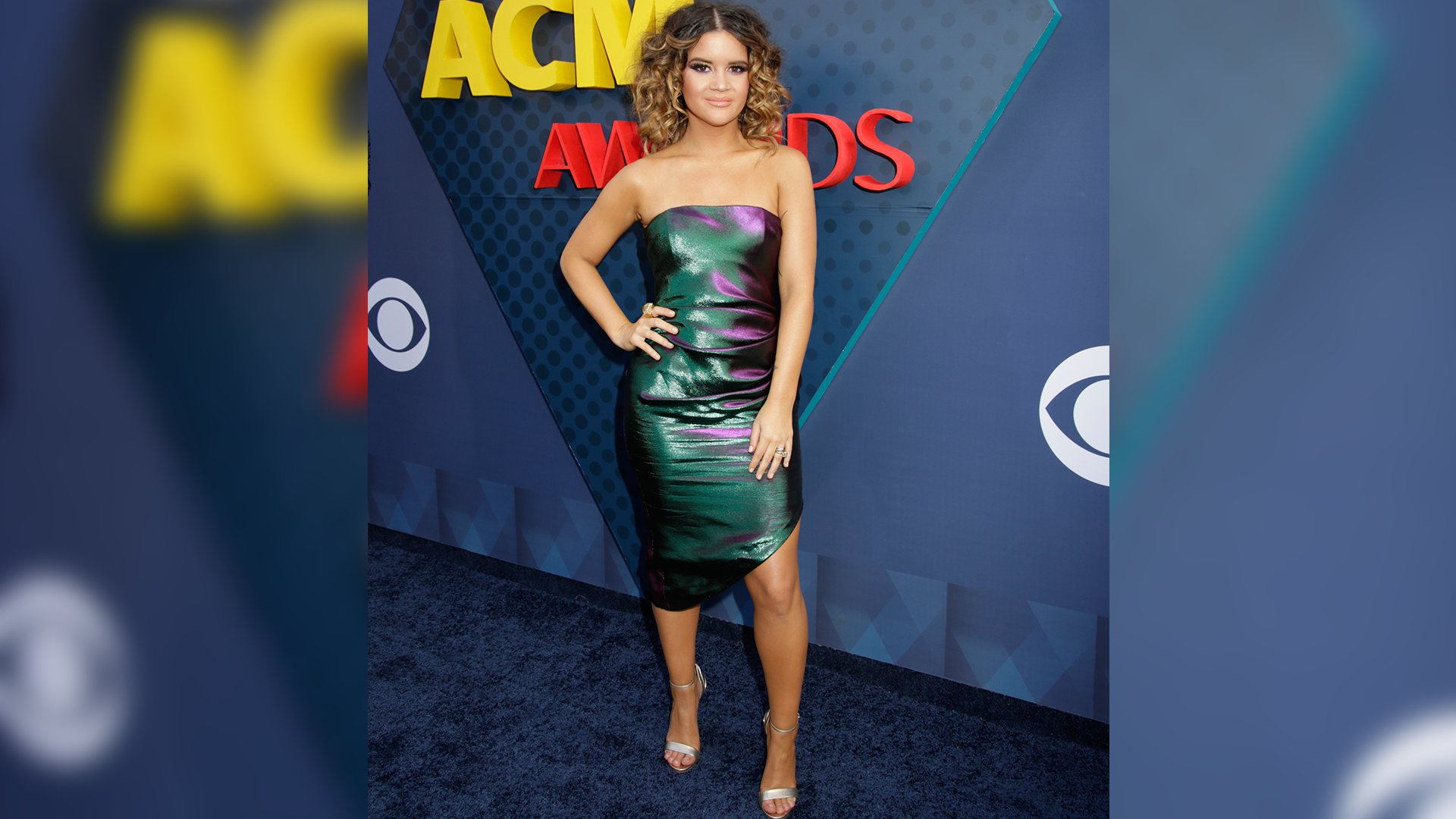Maren Morris catches our eye in more ways than one while wearing this iridescent, strapless mini-dress.