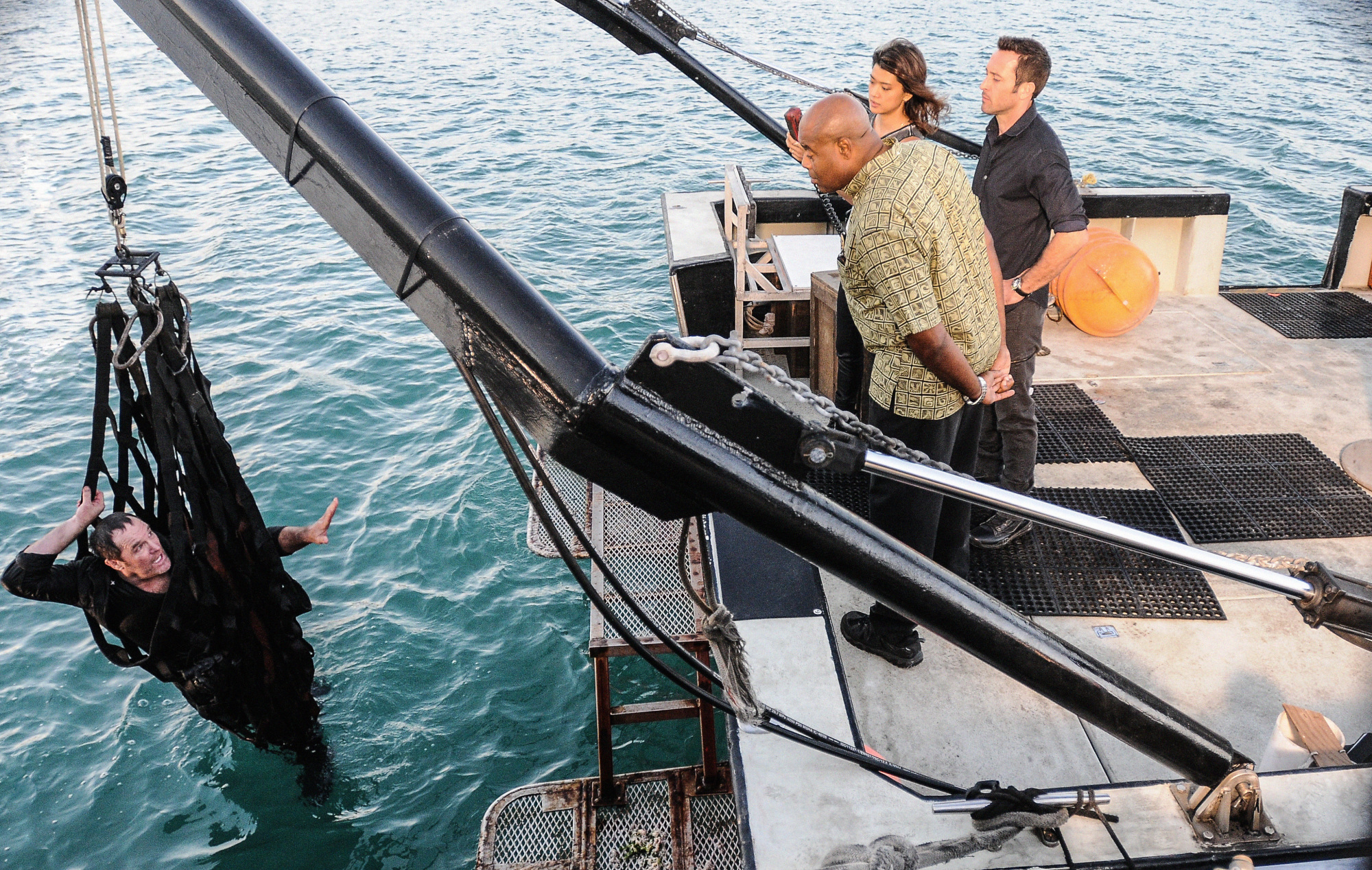 Chi McBride as Lou Grover, Grace Park as Kono Kalakaua, and Alex O'Loughlin as Steve McGarrett