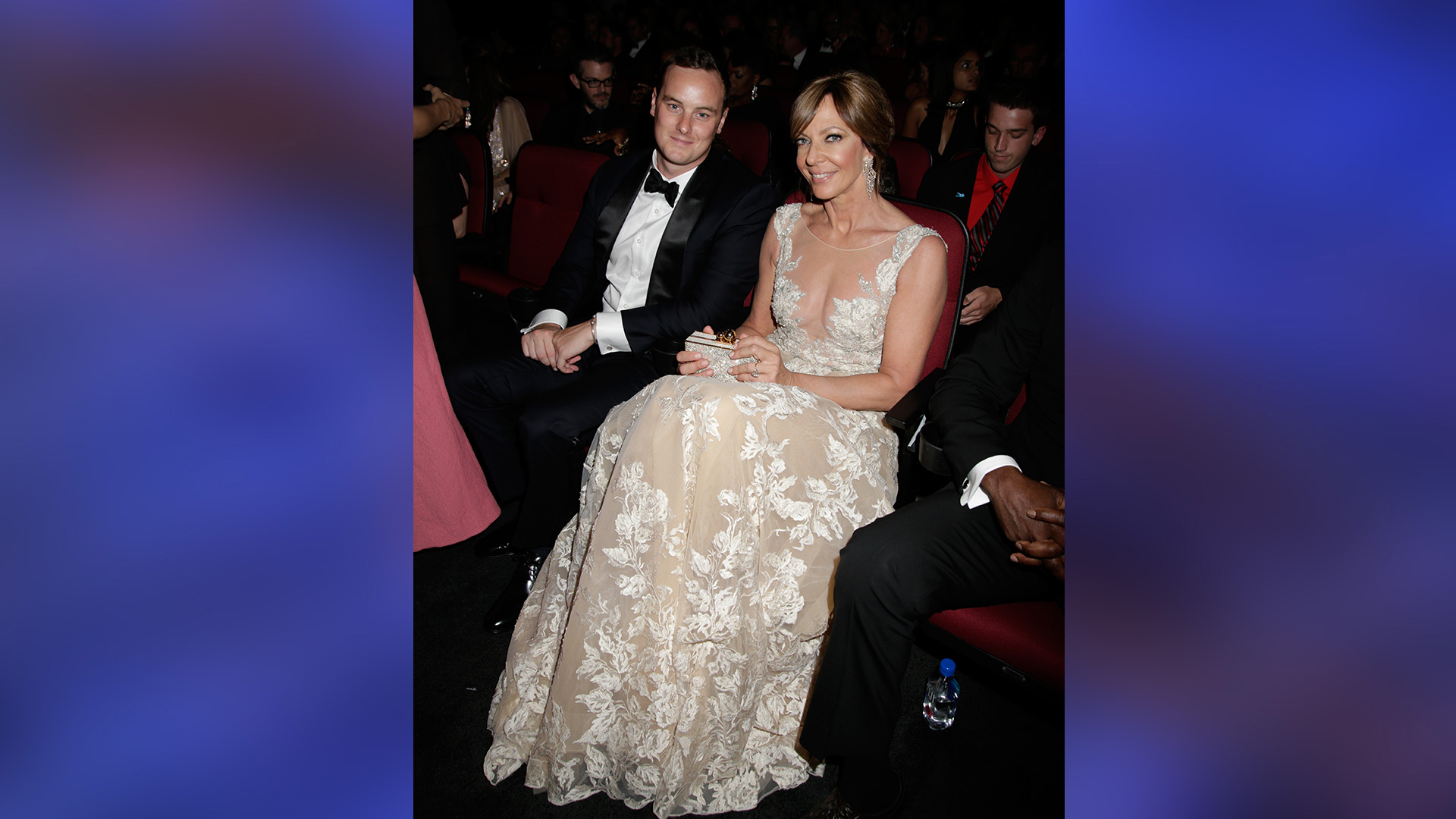 Allison Janney and her gorgeous gown demand attention while she sits in the audience with her nephew.