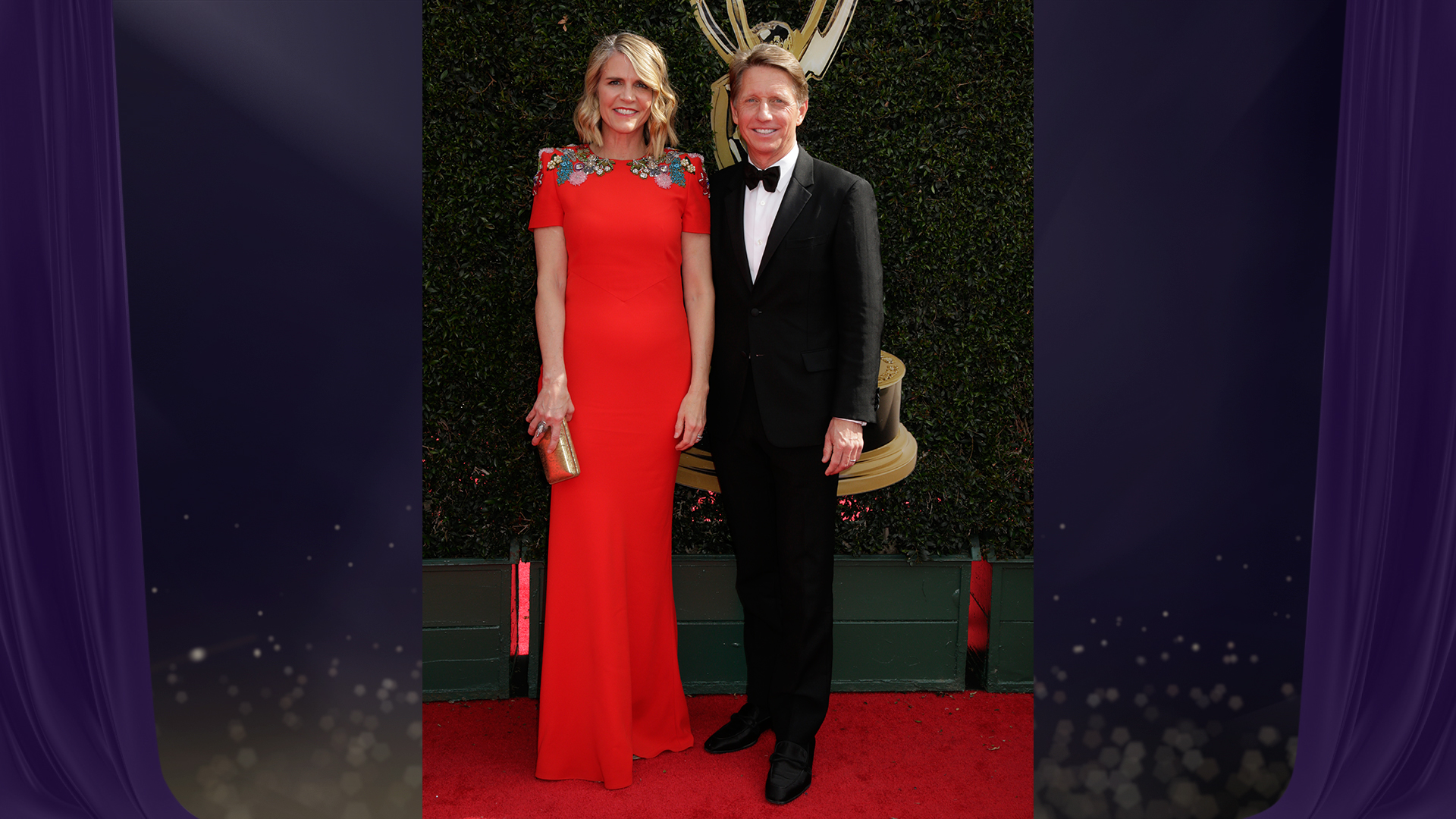 Bradley Bell, Executive Producer and head writer for The Bold and the Beautiful, poses with his wife on the Daytime Emmy red carpet.