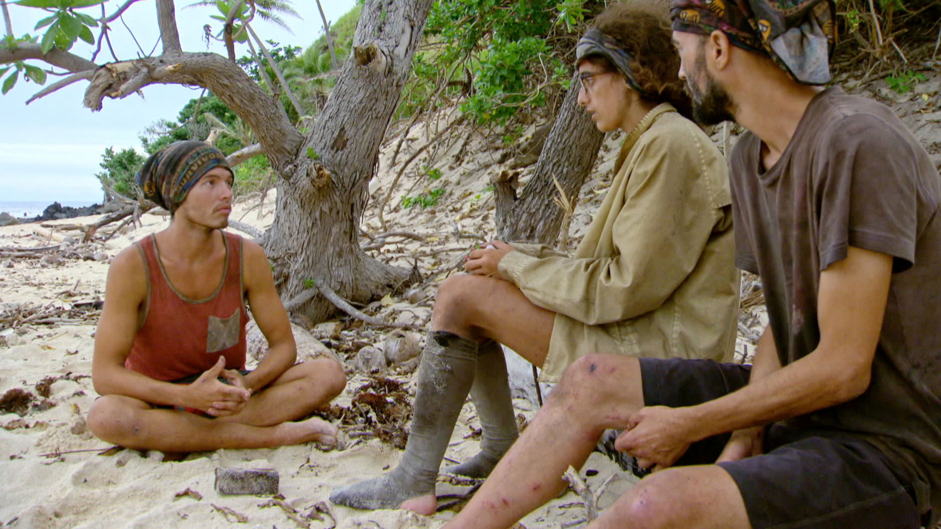 Jay talks to Hannah and David from his spot in the sand.