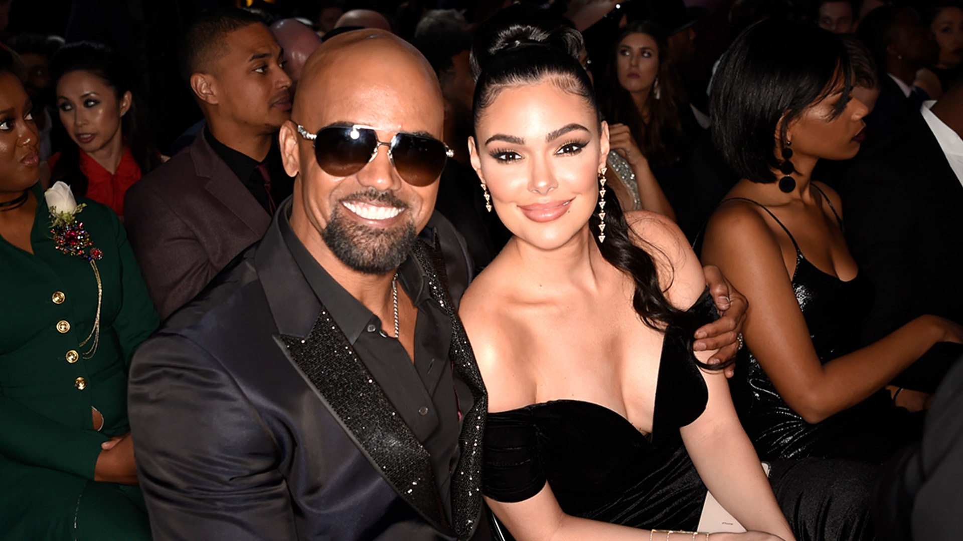 S.W.A.T. star and GRAMMY presenter Shemar Moore throws an arm around his co-star Lina Esco.
