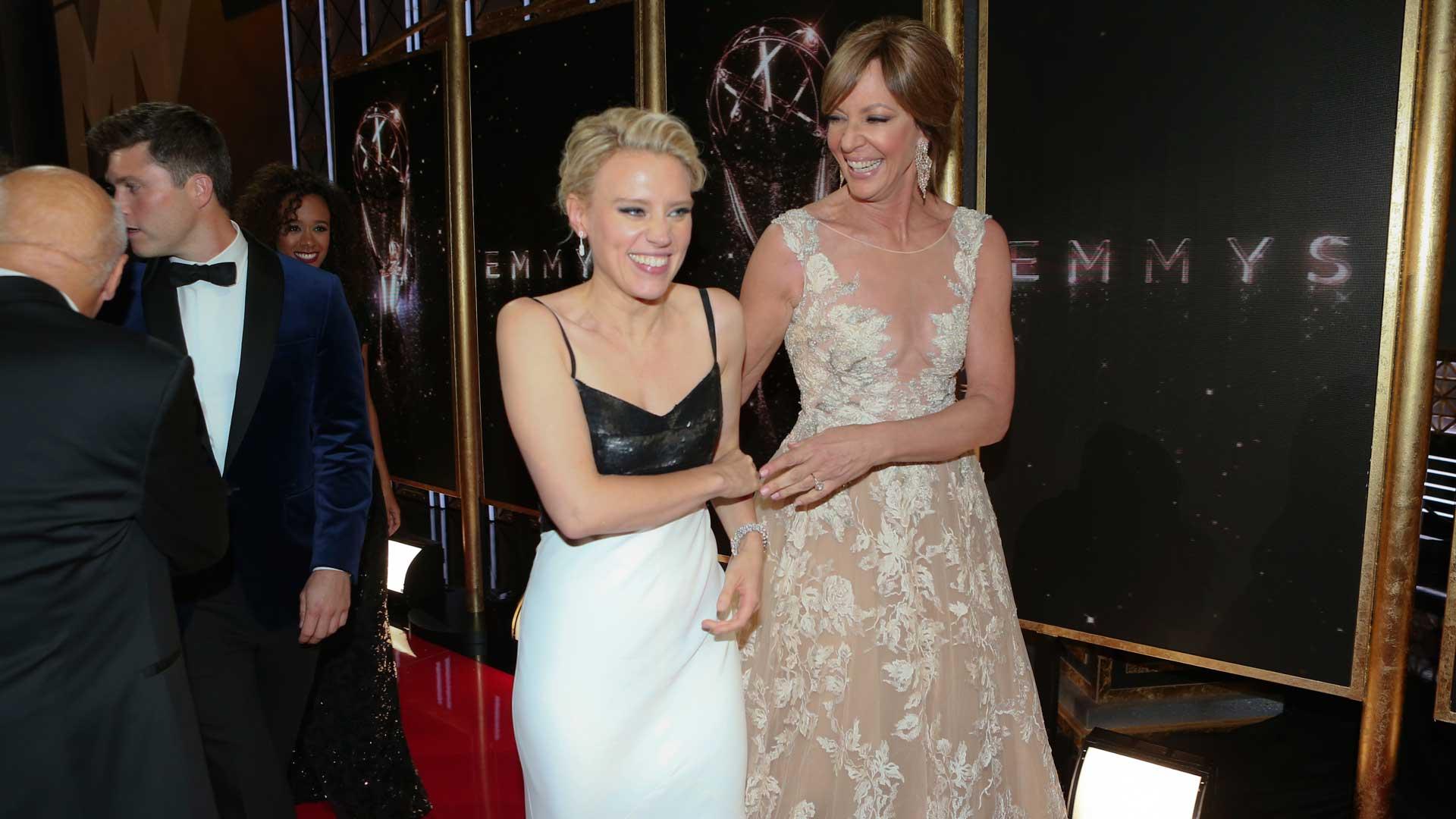 Allison Janney escorts Emmy winner Kate McKinnon off stage.