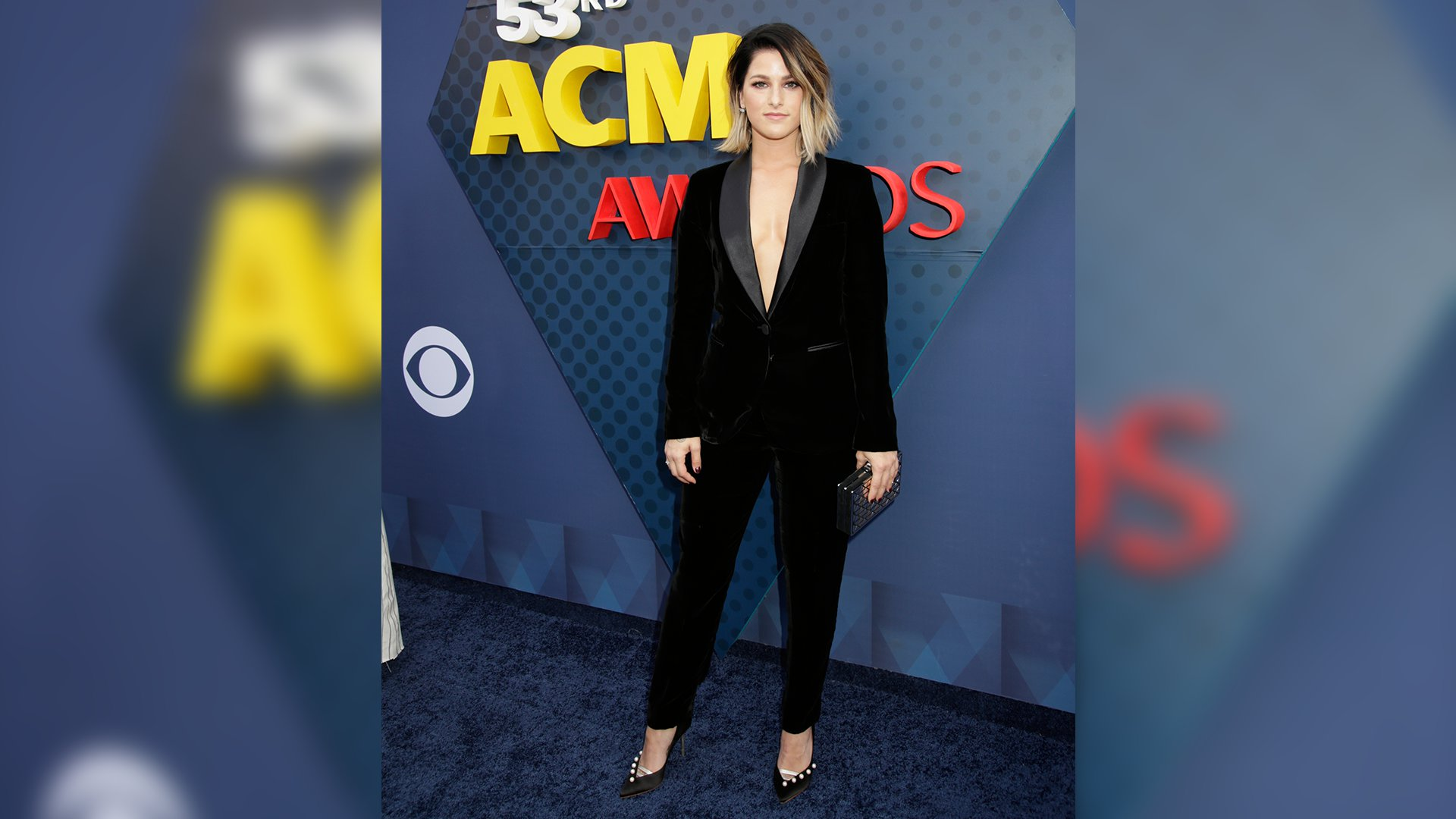 Cassadee Pope takes the idea of black tie to another level in this gorgeous tuxedo suit.