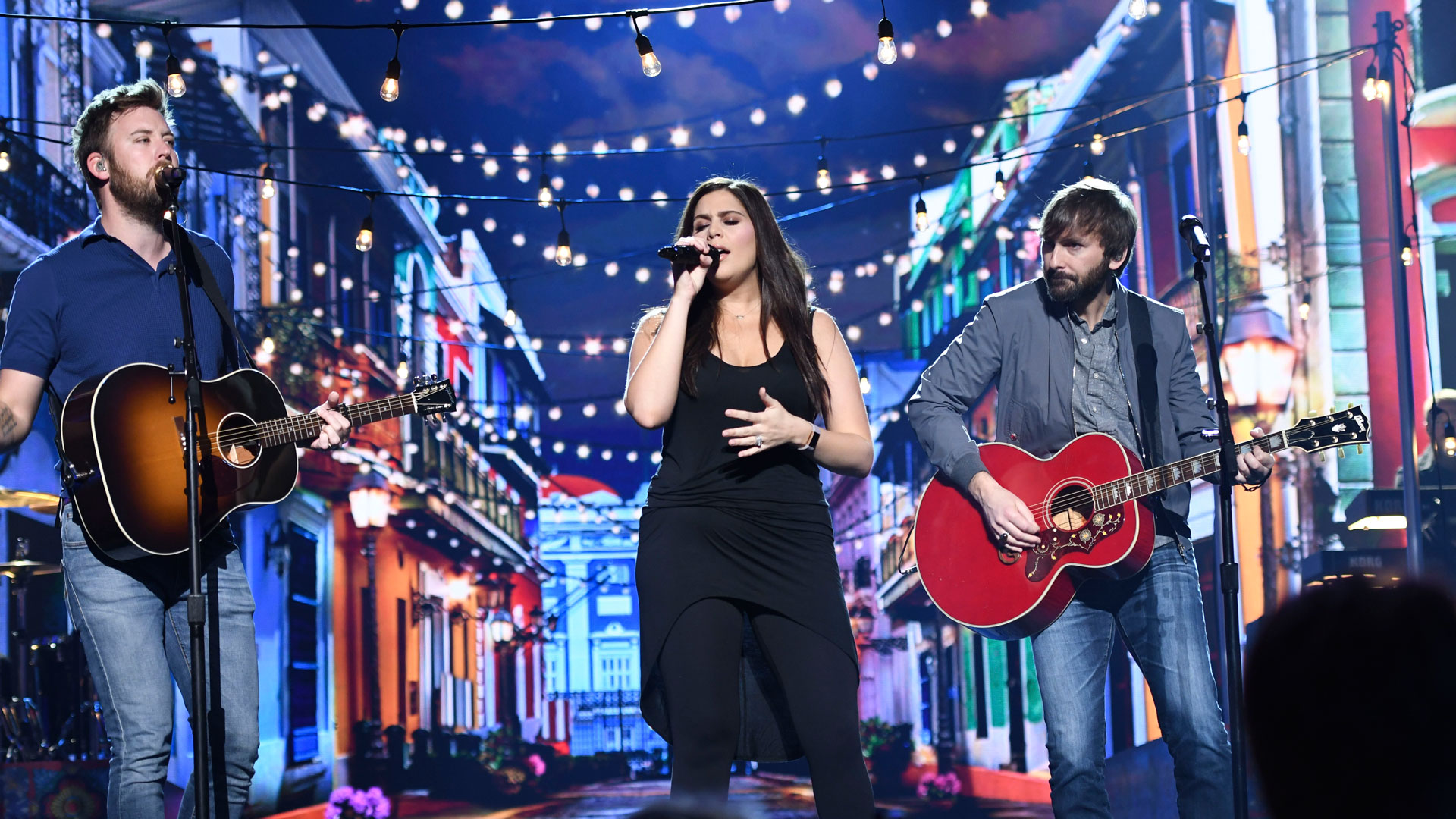 Lady Antebellum rehearse amidst a slew of stringed lights on stage set for the 53rd ACM Awards.