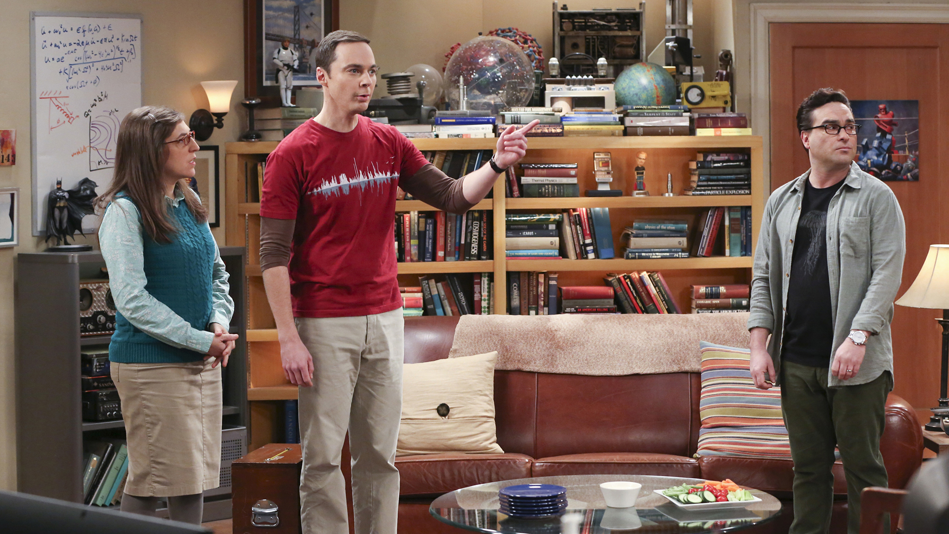 Sheldon hassles Leonard about his Christmas decorations being up too long.