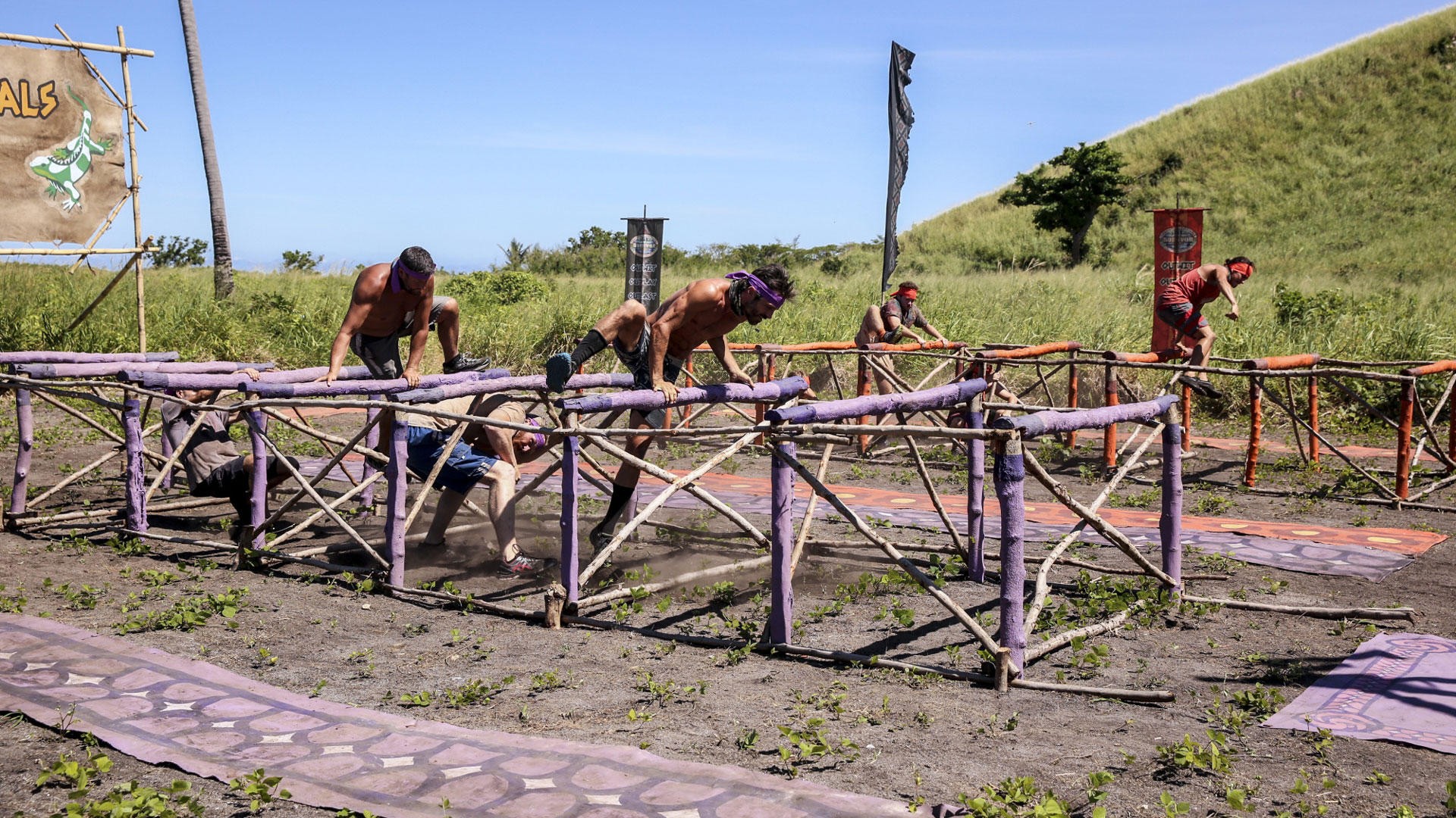 Castaways must weave around hurdles in this obstacle course.