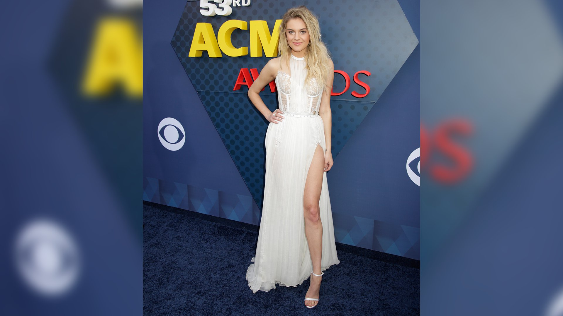 Kelsea Ballerini might hate love songs, but it looks like she's not opposed to gowns with high necks and a side slit.