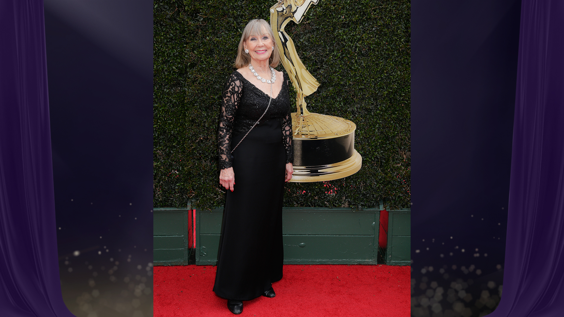 Y&R grand dame Marla Adams, who's nominated for Outstanding Supporting Actress in a Drama Series, shows off an oversized diamond statement necklace with her black lace dress.