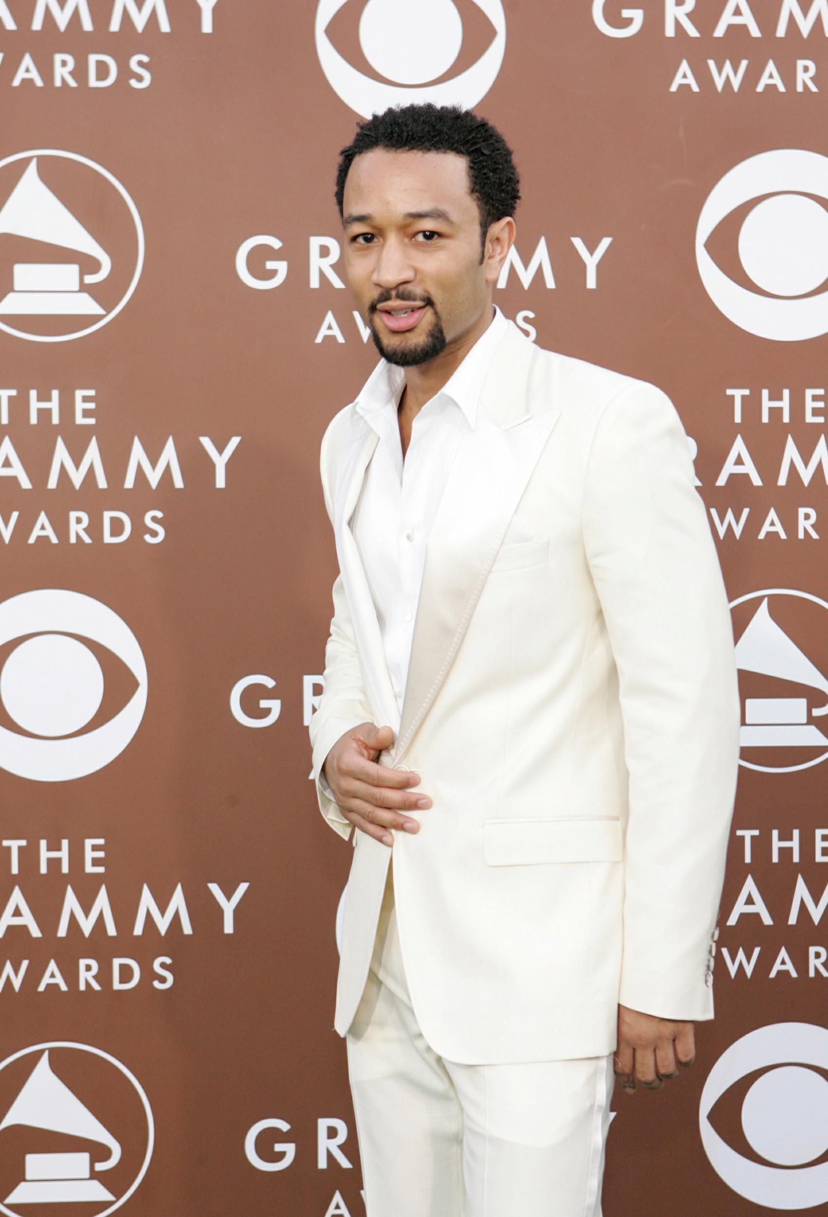 8. John Legend in white