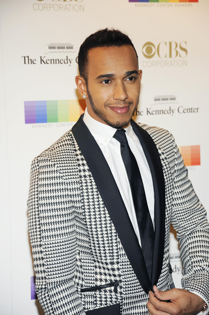 Racing driver Lewis Hamilton sports an eye-catching houndstooth suit.