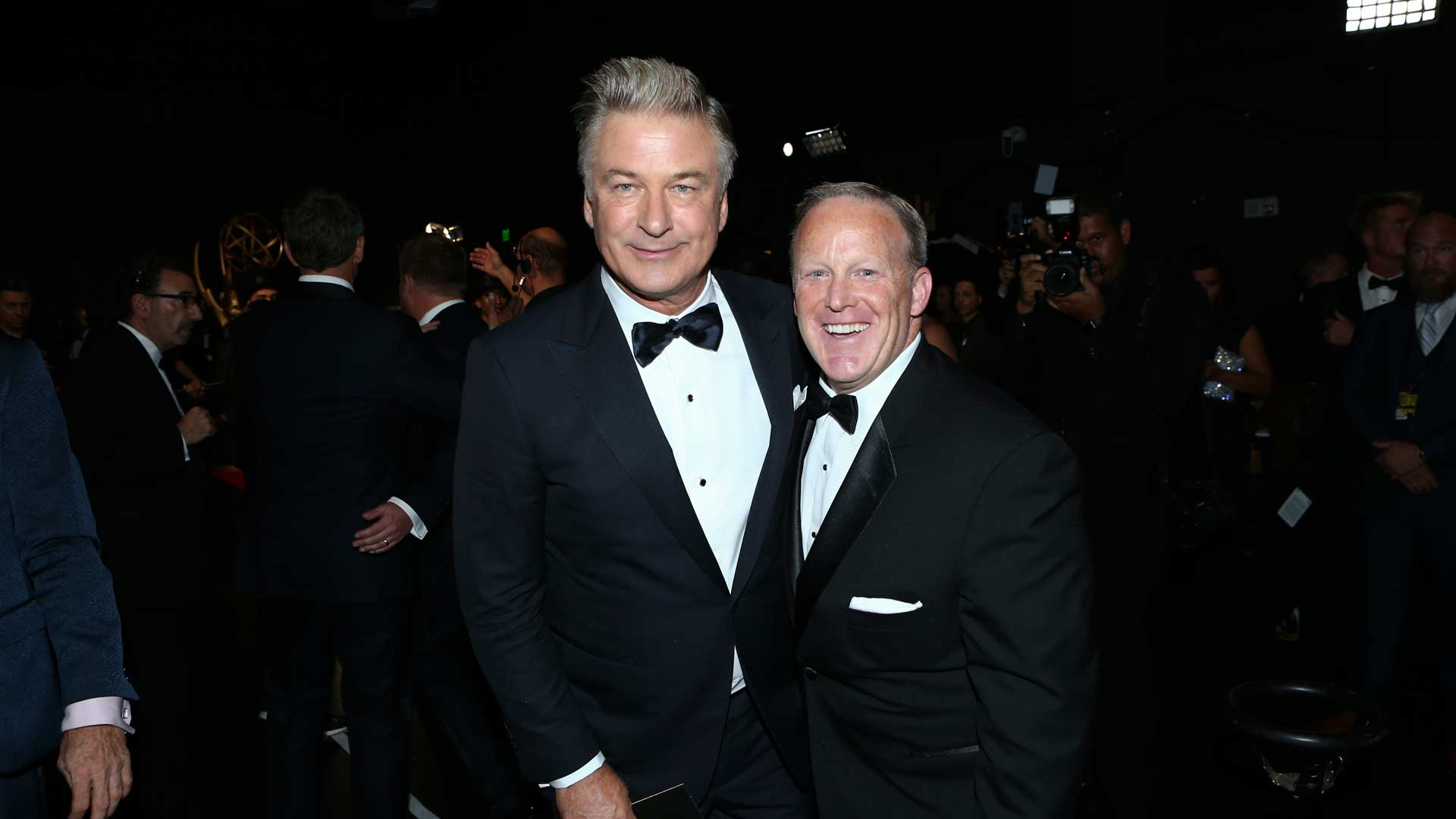 Alec Baldwin stops for a photo-op with former White House Press Secretary Sean Spicer.