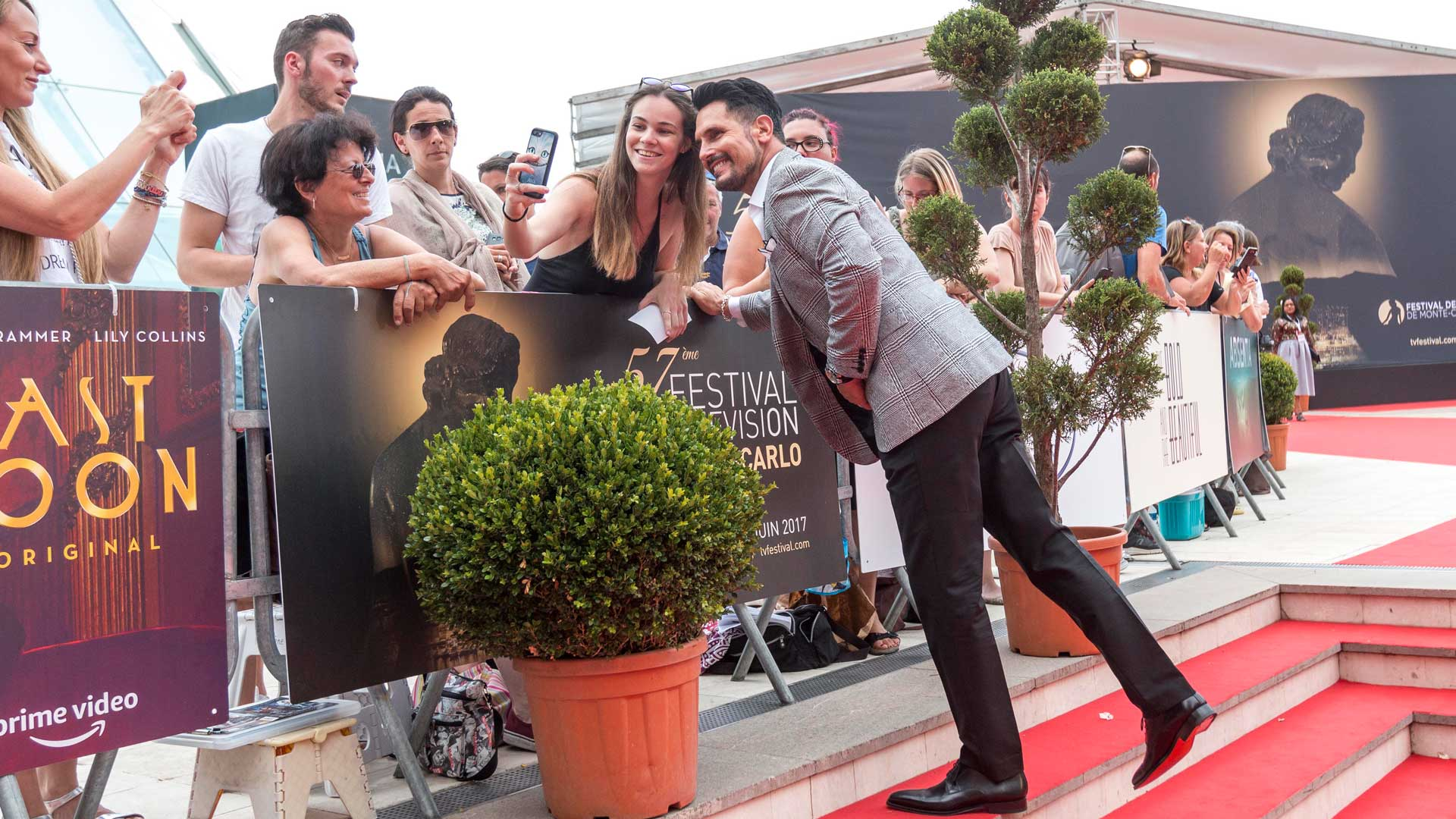 Don Diamont steps off the red carpet to pose for selfies with fans.