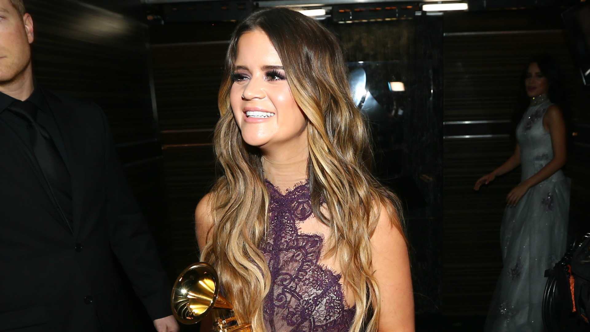 Maren Morris walks around in a lacey plum number after winning Best Country Solo Performance.