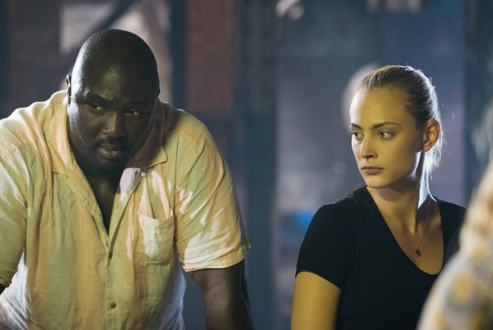 Nonso Anozie as Abraham Kenyatta and Nora Arnezeder as Chloe Tousignant.