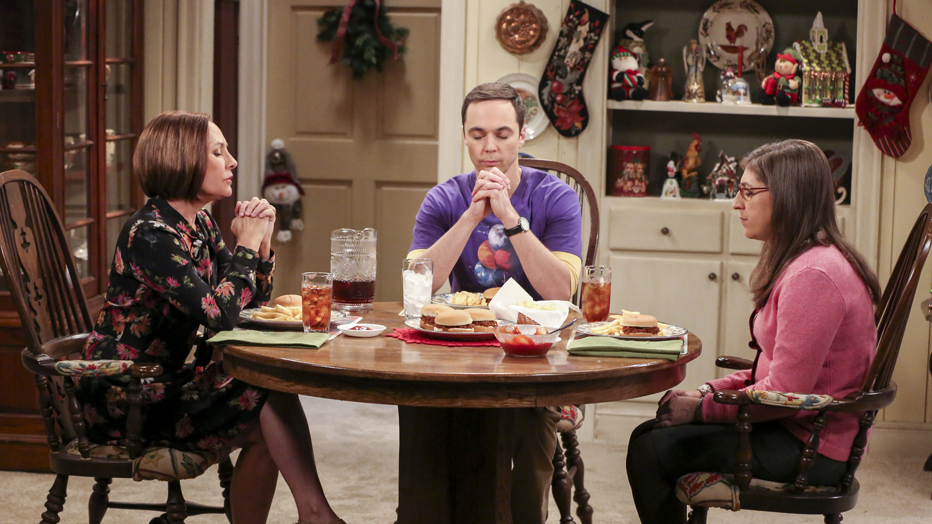 Mary, Sheldon, and Amy say grace around the holiday dinner table.