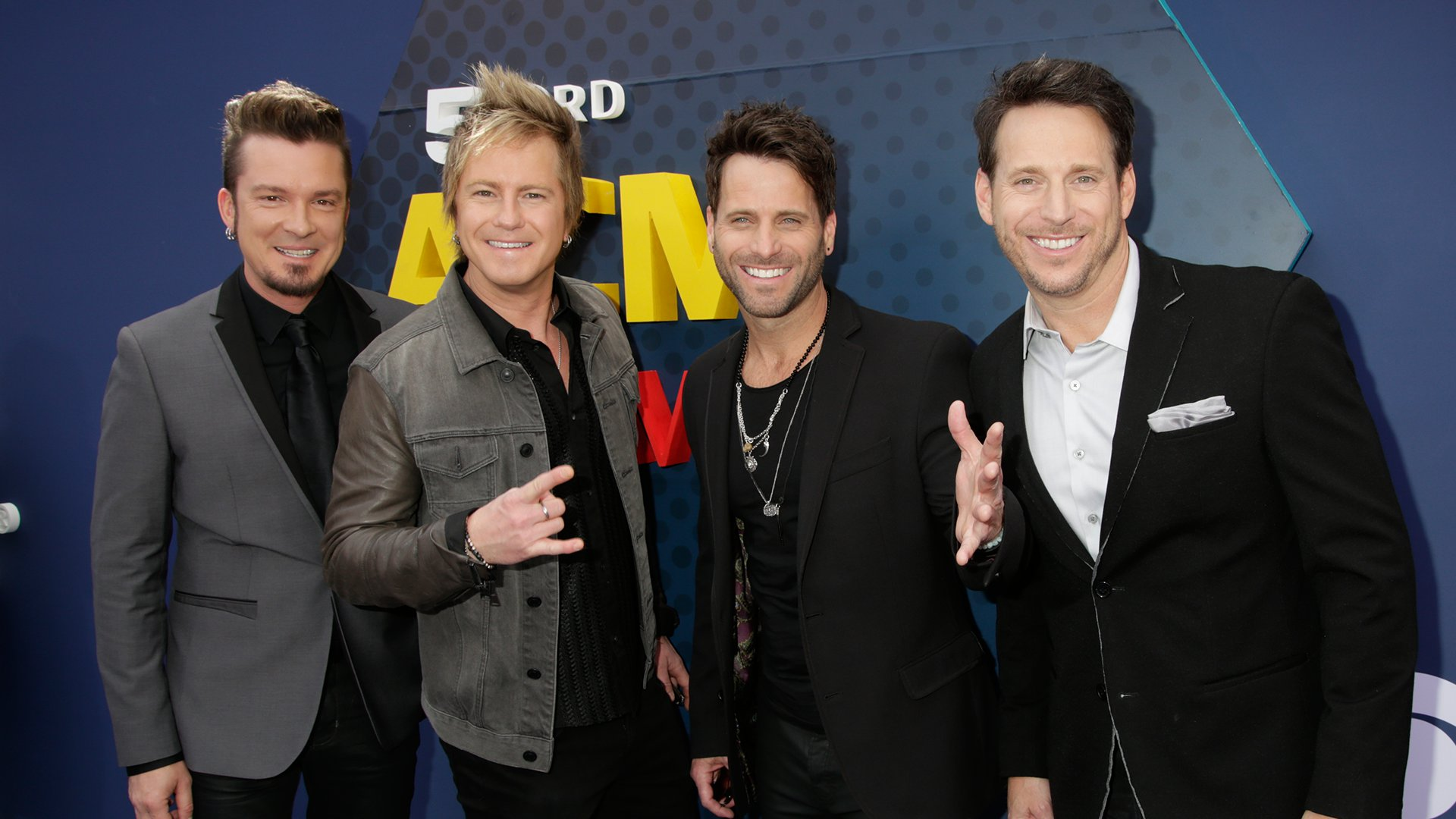 The members of Parmalee wear a variety of different textures on the red carpet, including velvet and denim.