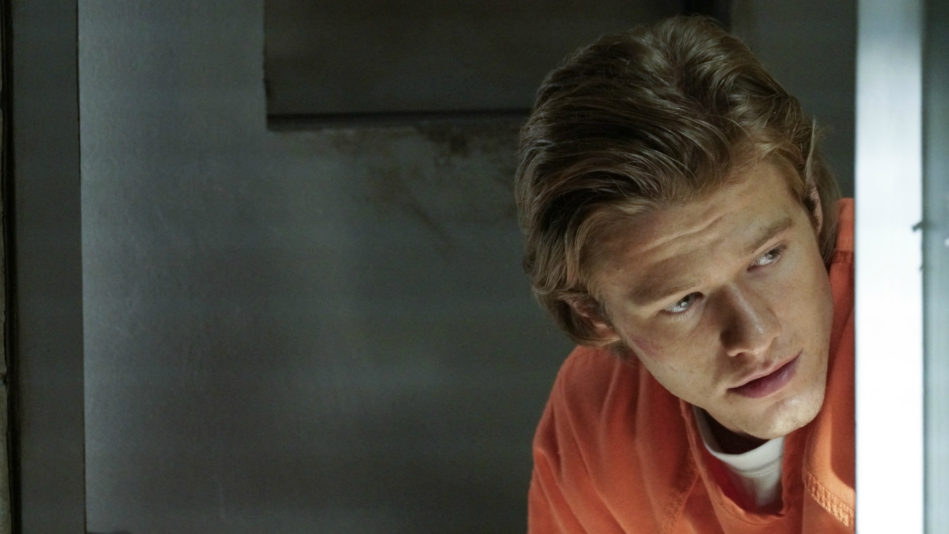 MacGyver looks out from his jail cell.