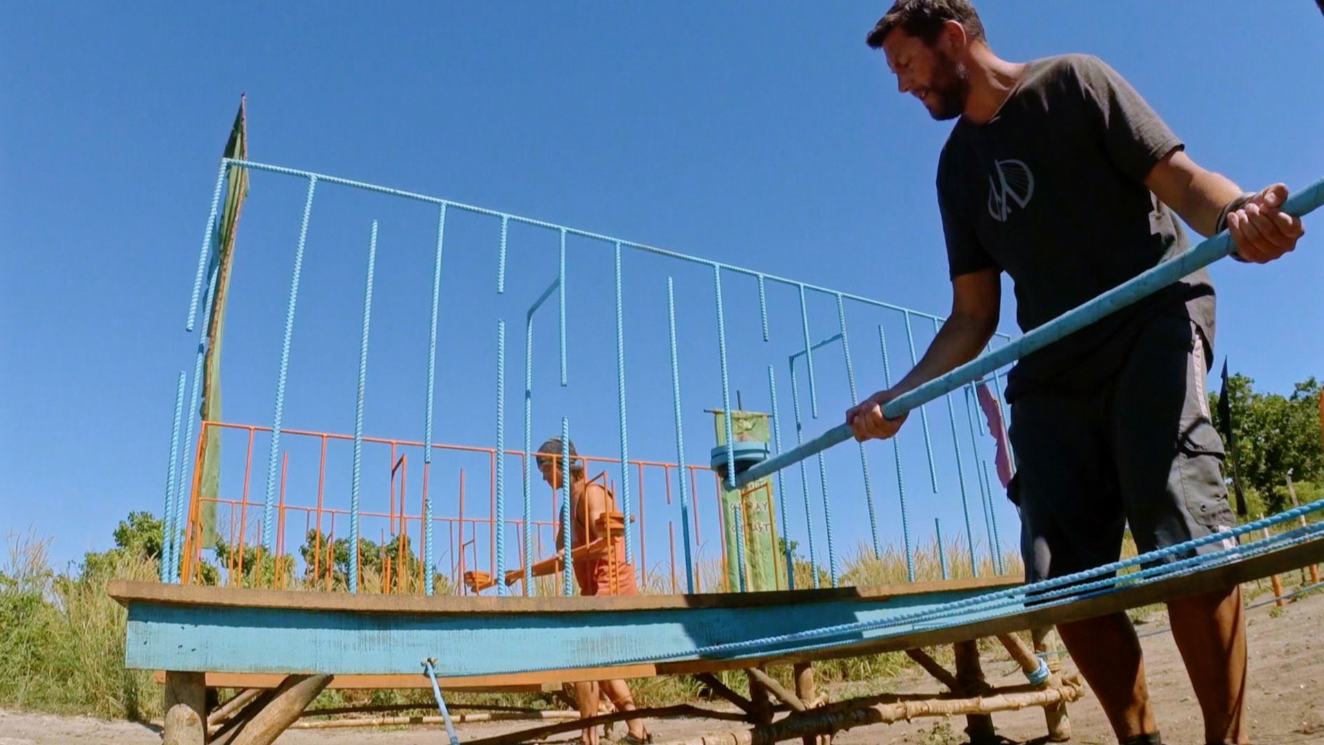 Bret wiggles his pole through the wire maze.