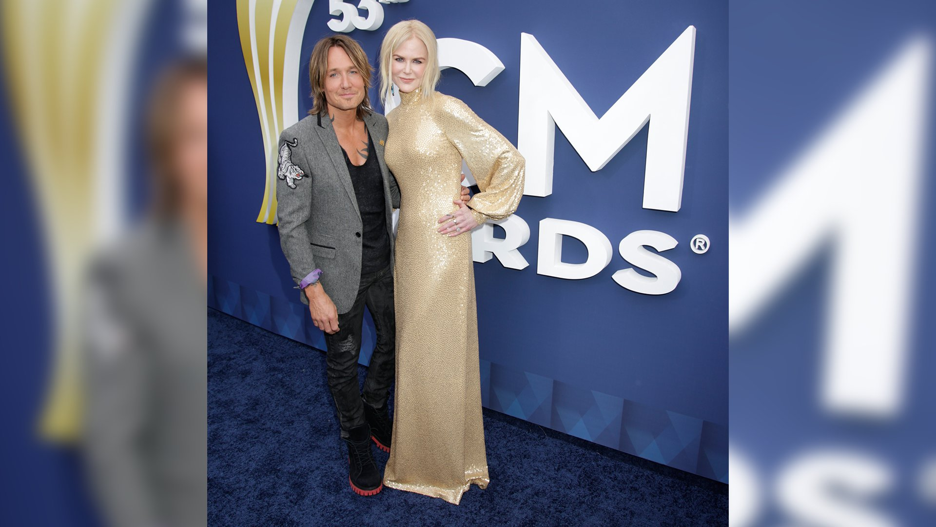 Keith Urban poses with wife Nicole Kidman, who looks statuesque in a floor-length gold gown.