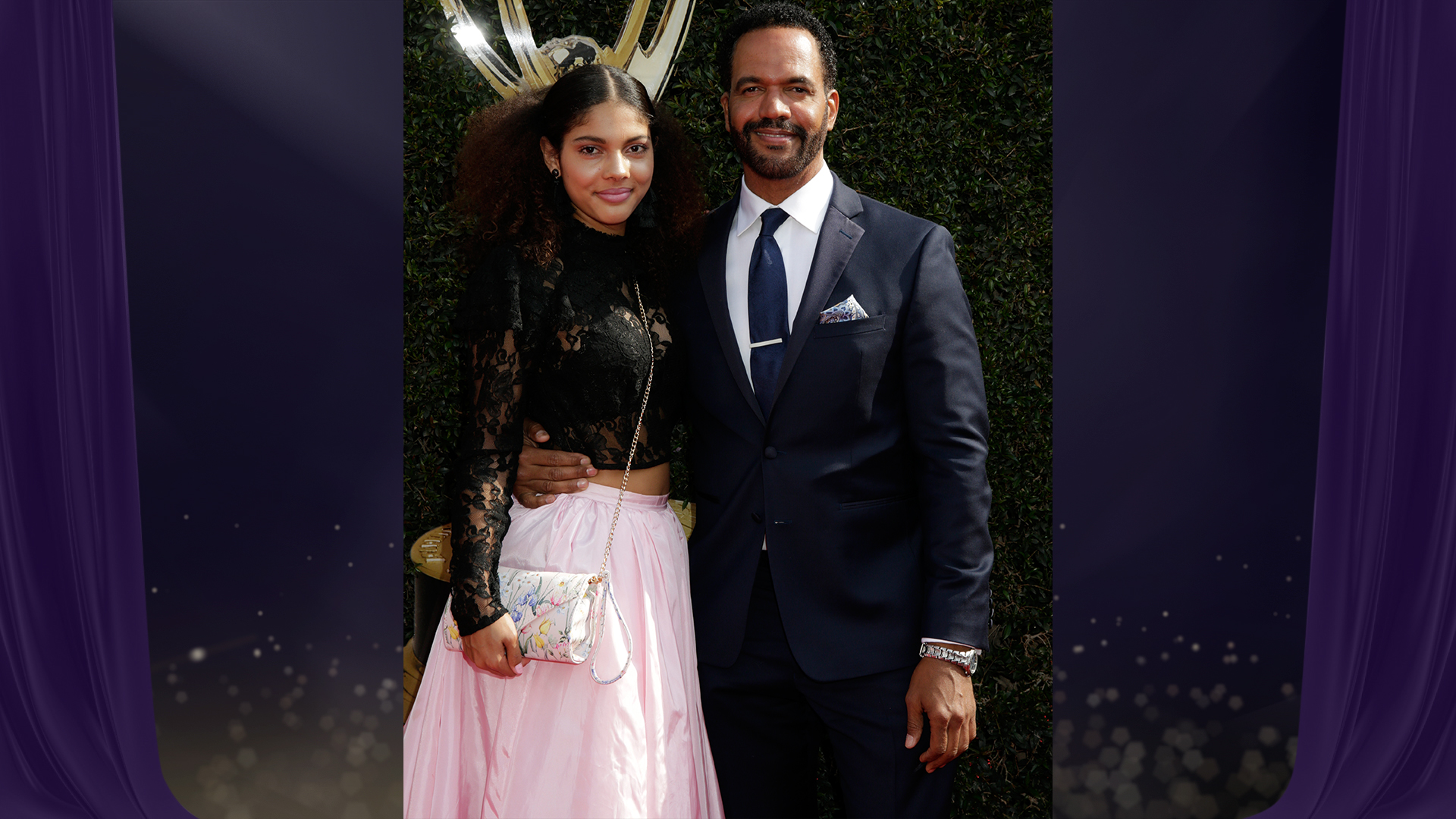 The Young and the Restless star Kristoff St. John stops for a photo with his daughter on the red carpet before heading inside to present.