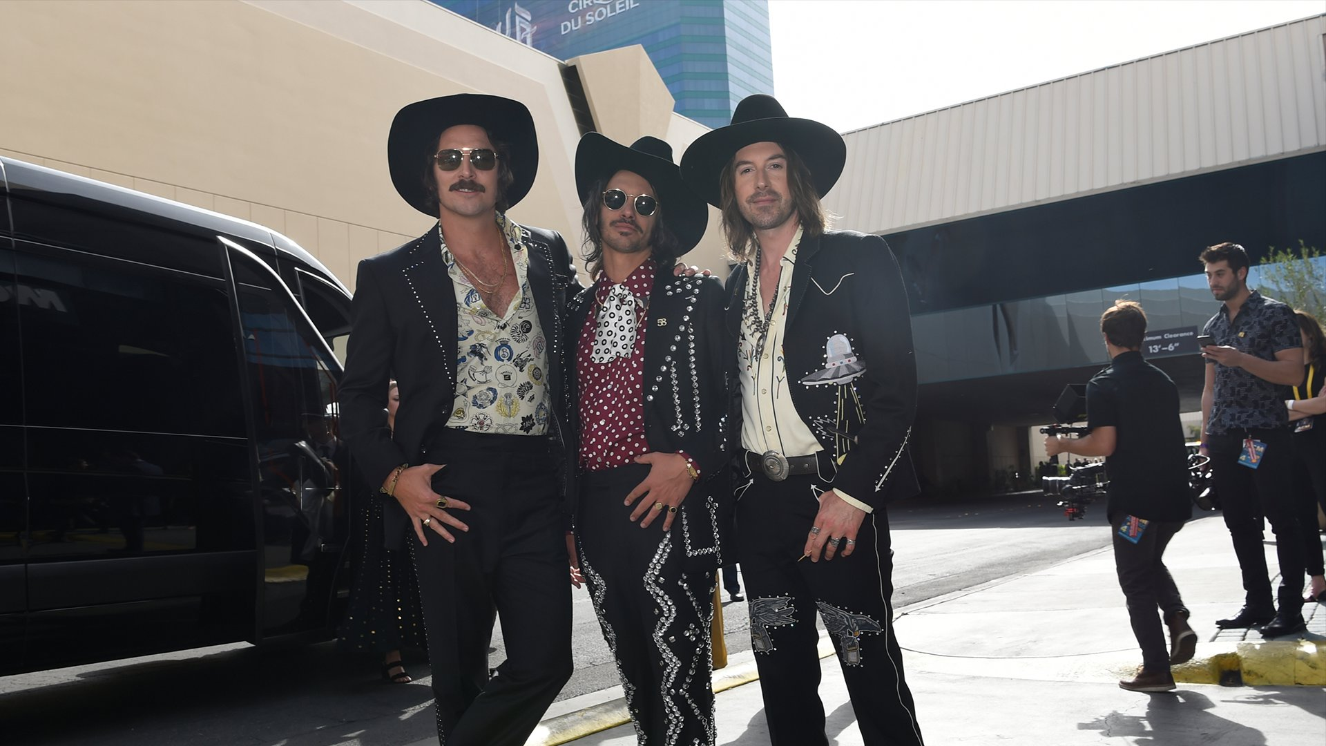 Midland, winner of New Vocal Duo or Group of the Year, wear matching cowboy hats on the ACM red carpet.