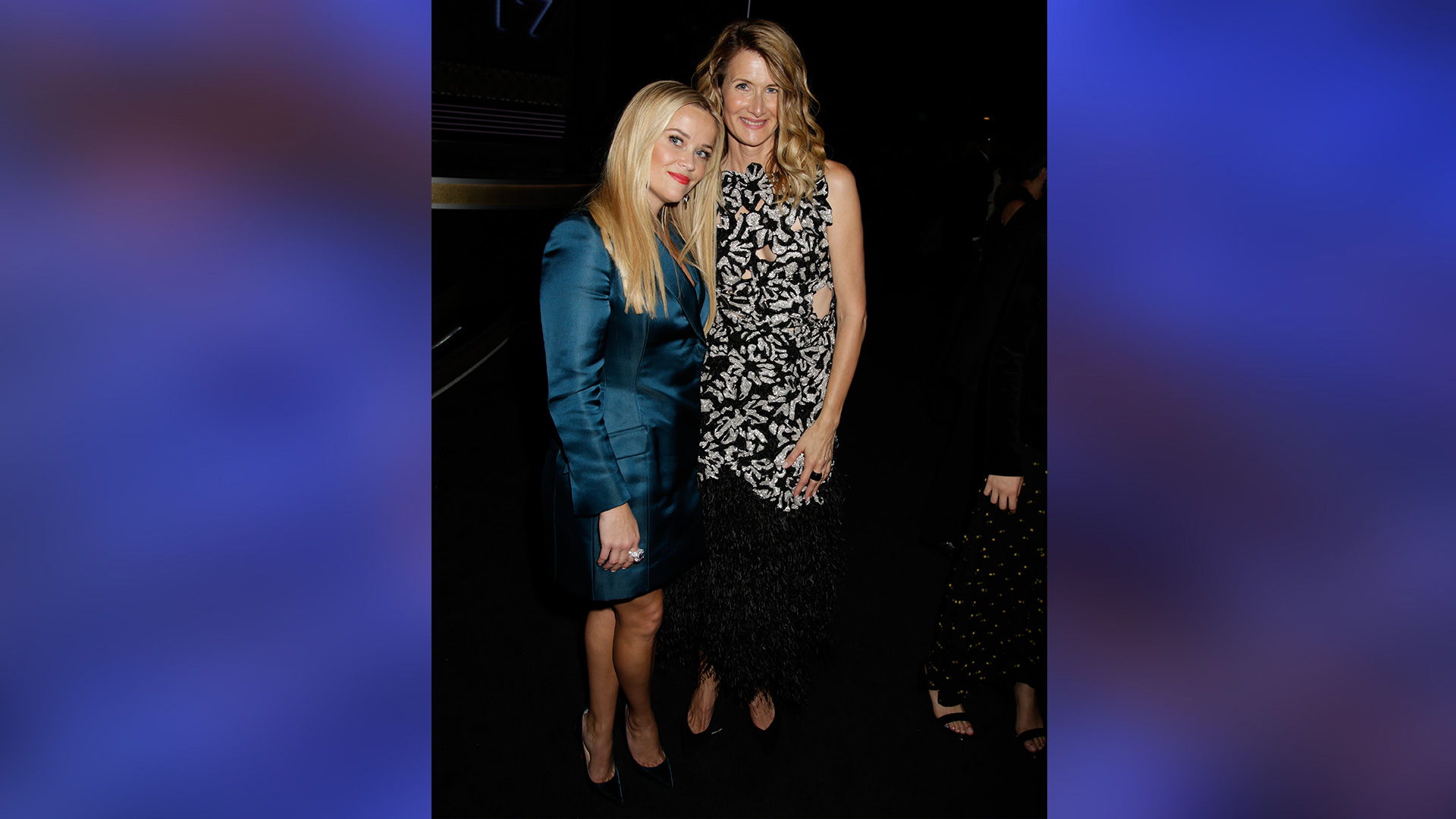 Reese Witherspoon snuggles with Big Little Lies co-star and Emmy winner Laura Dern.
