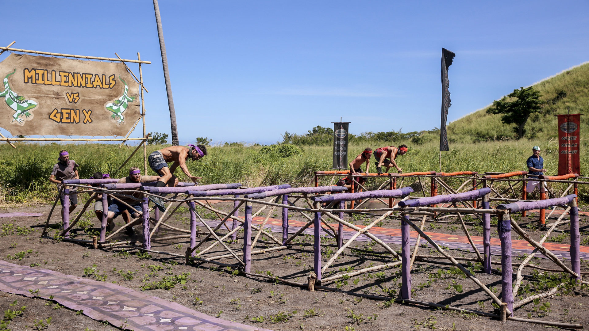 Members of two teams race through a series of obstacles.