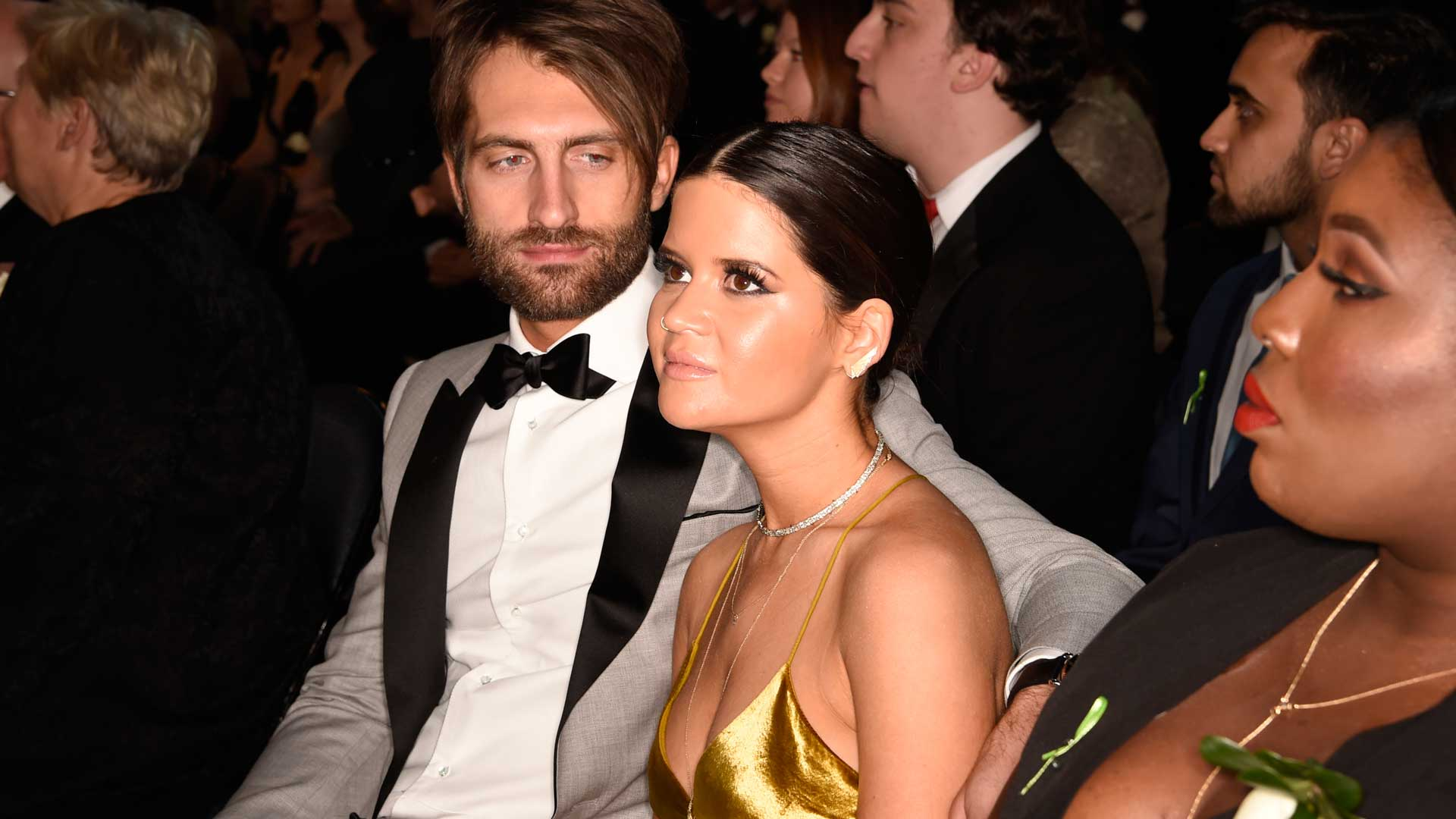 Country songstress and GRAMMY performer Maren Morris takes her seat beside her fiancé, Ryan Hurd.