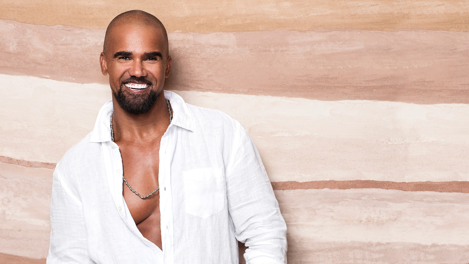 Shemar Moore puts on a happy face