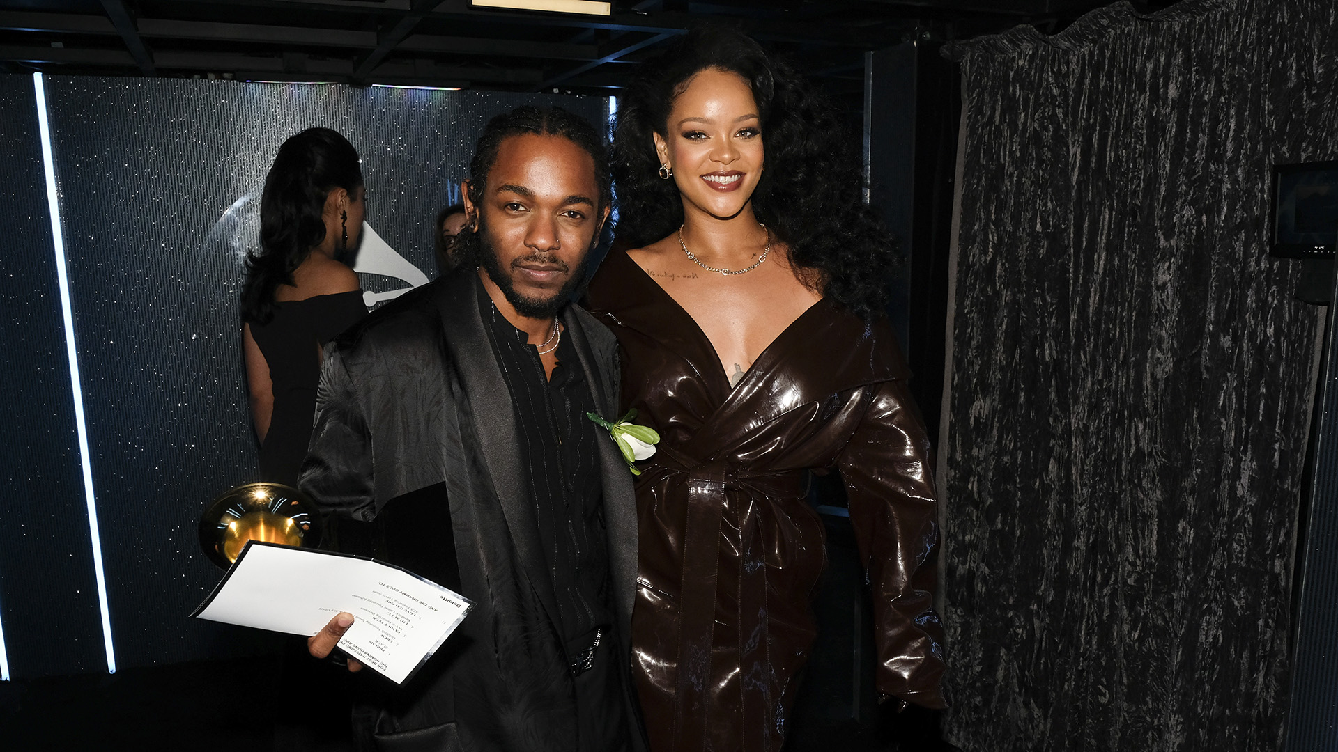 Hip-hop figurehead Kendrick Lamar walks backstage with R&B/pop superstar Rihanna after accepting a trophy for Best Rap/Sung Collaboration.