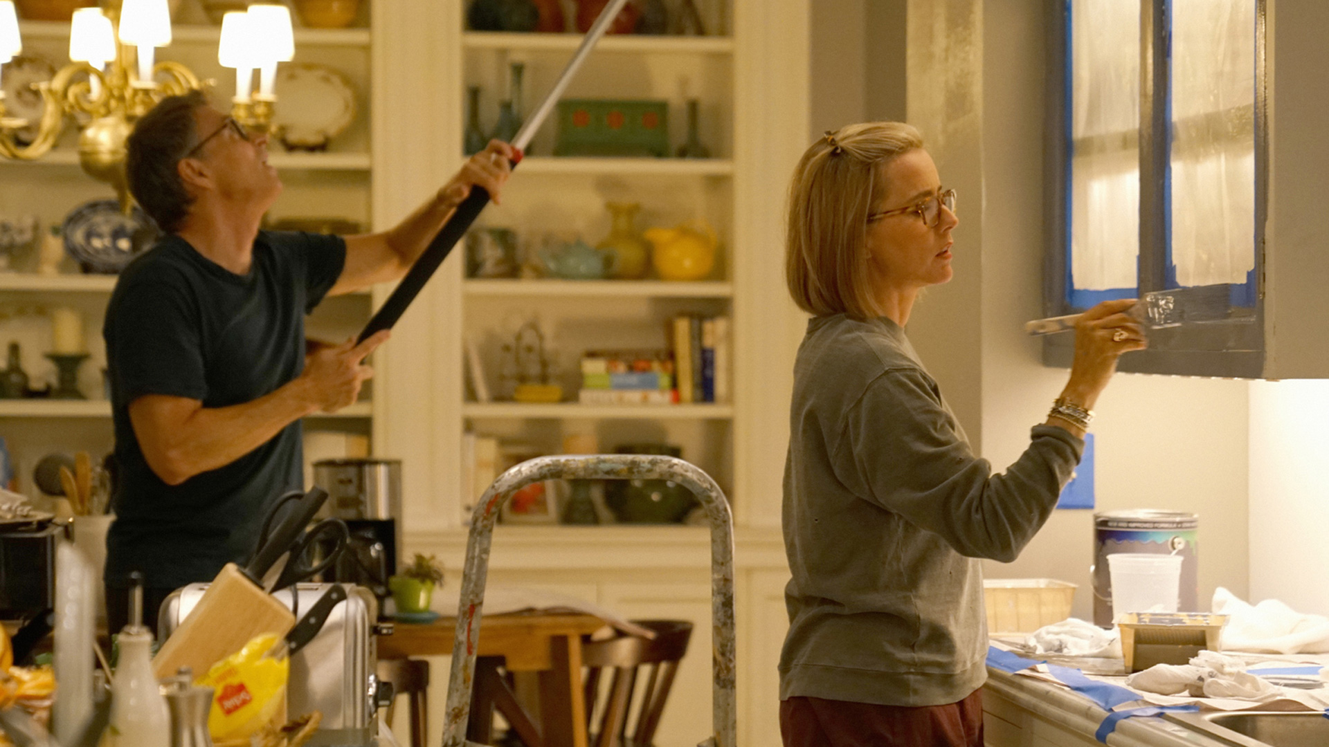Tim Daly (Henry McCord) and Téa Leoni (Elizabeth McCord) freshen up the kitchen.