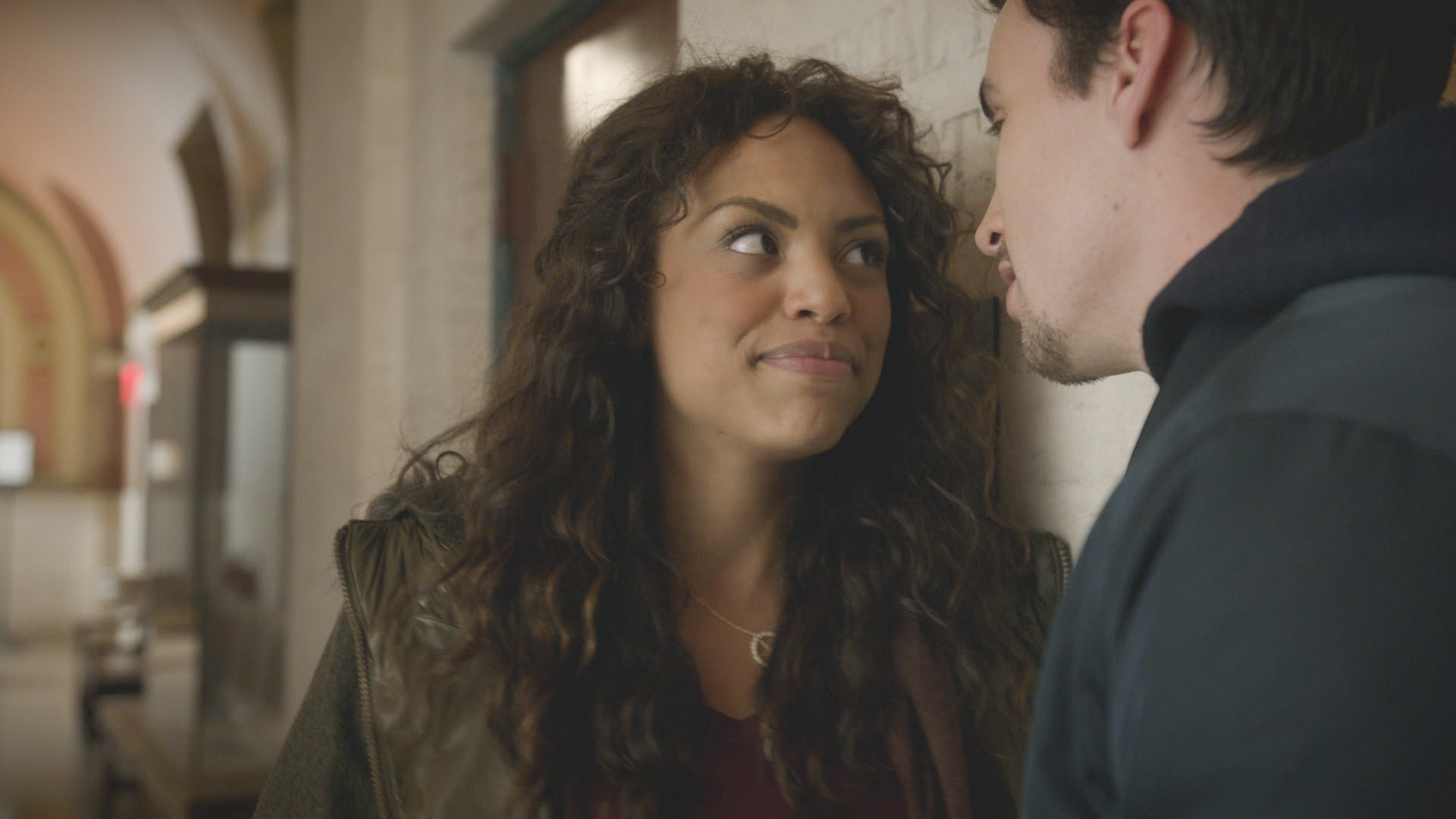 Danny meets with her boyfriend in the courthouse hallway.