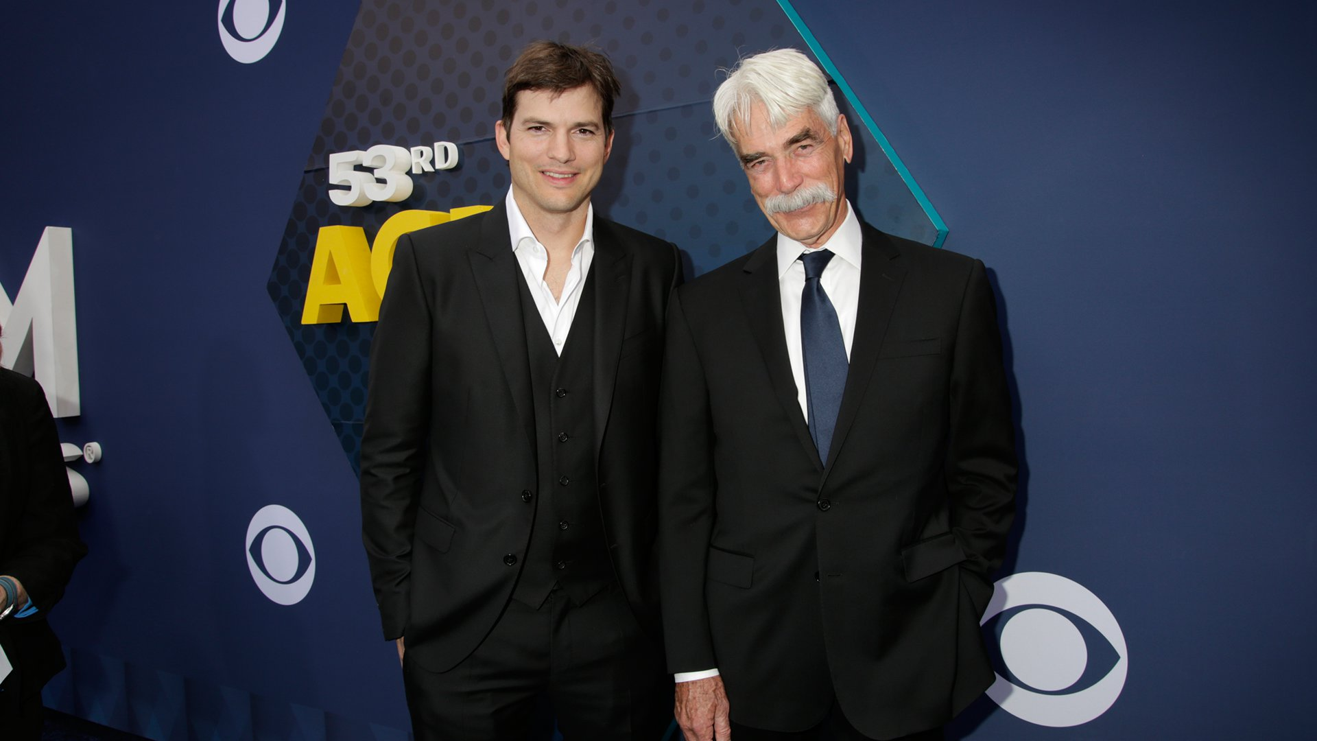 Ashton Kutcher and Sam Elliott, stars of The Ranch, take a break from filming to attend the 53rd ACM Awards.