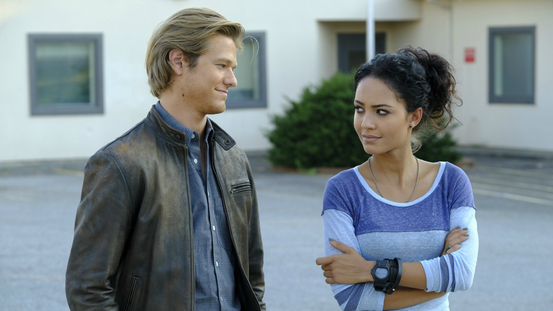 MacGyver gives Riley a knowing look.