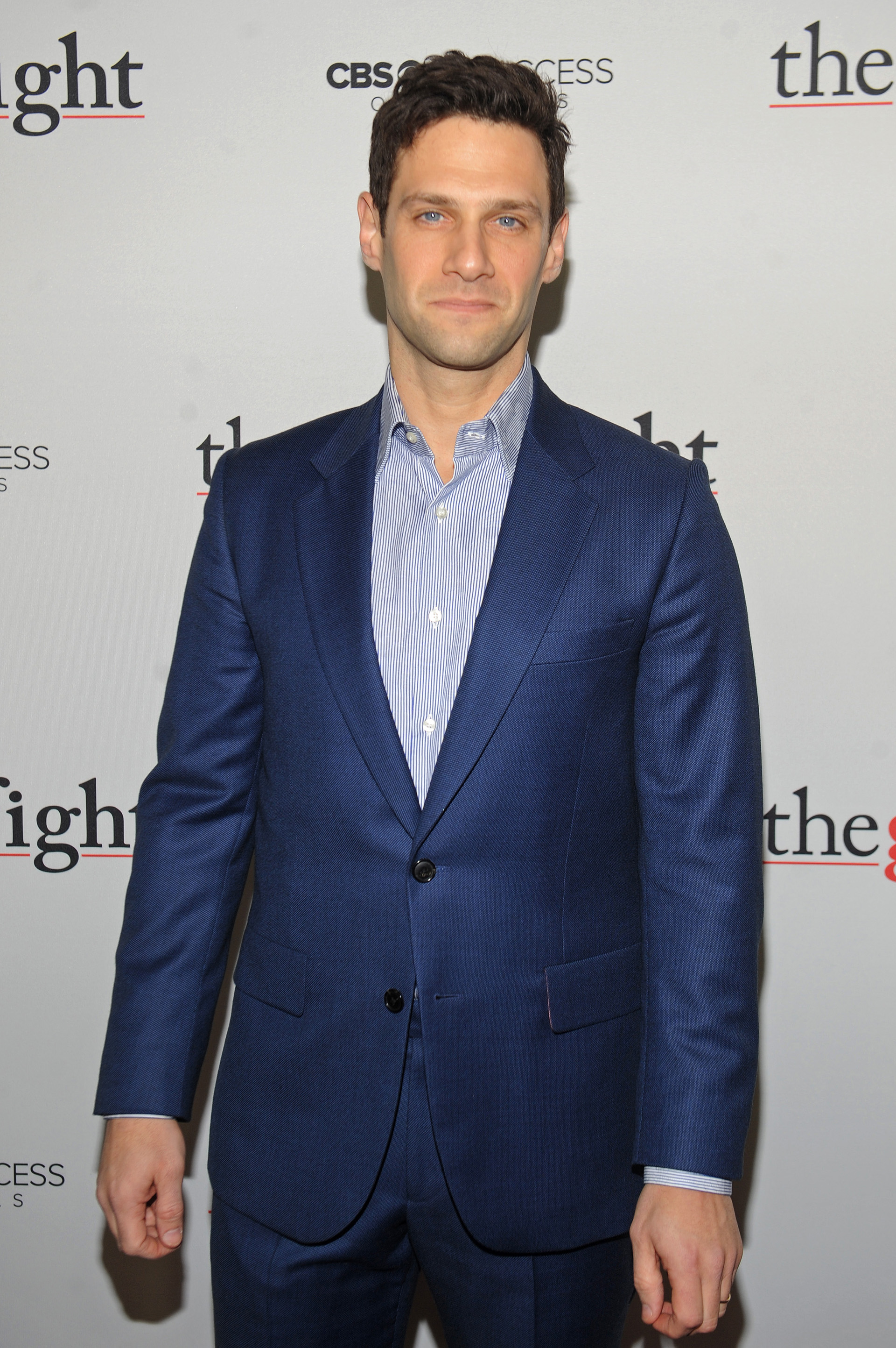 Justin Bartha is ready for action in a sleek, royal blue suit.