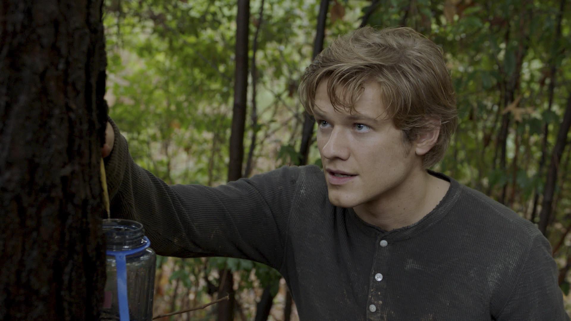 MacGyver surveys the scene around him.