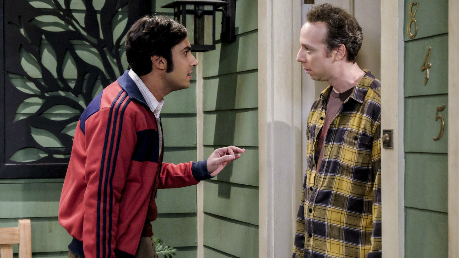 Raj and Stuart butt heads outside the Wolowitz house.