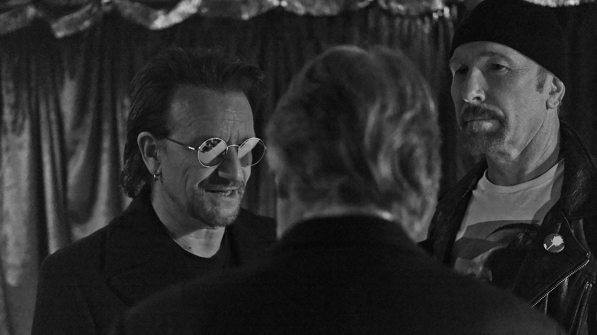 Irish rock legends Bono and The Edge pause to confer backstage in between performances at the 60th Annual GRAMMY Awards.