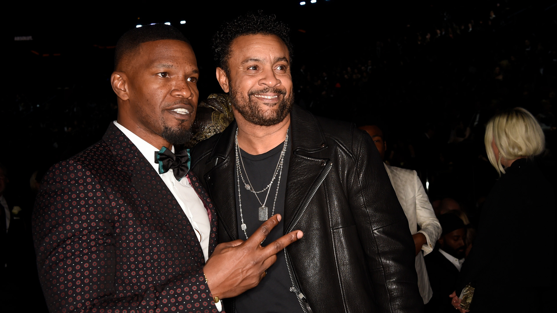 Actor Jamie Foxx throws up a peace sign alongside 60th Annual GRAMMY Awards performer Shaggy.